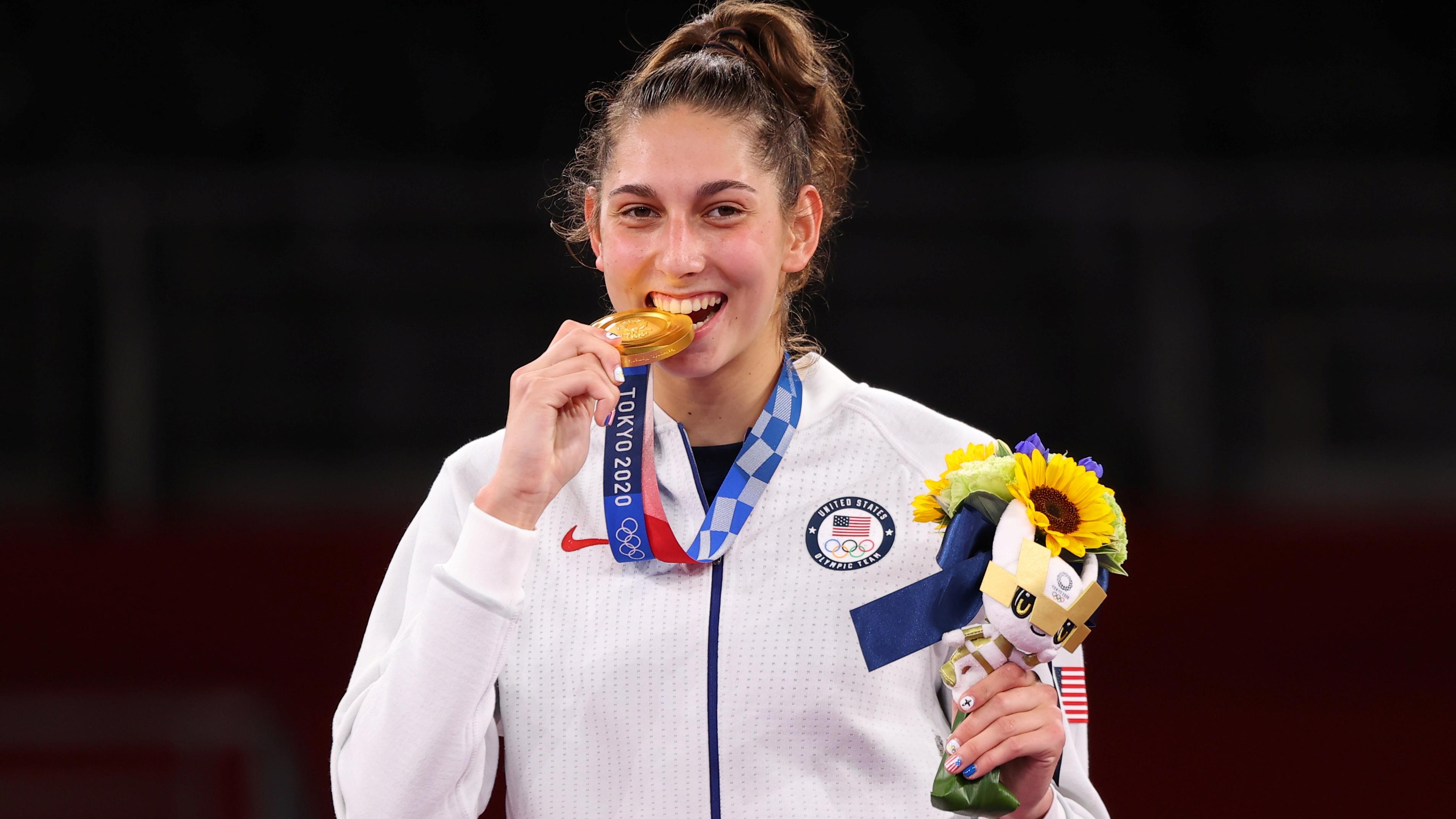 Tokyo 2020 Olympics - Taekwondo - Women's Featherweight 49-57kg - Medal Ceremony - Makuhari Messe Hall A, Chiba, Japan - July 25, 2021. Anastasija Zolotic of the United States celebrates winning gold REUTERS/Murad Sezer