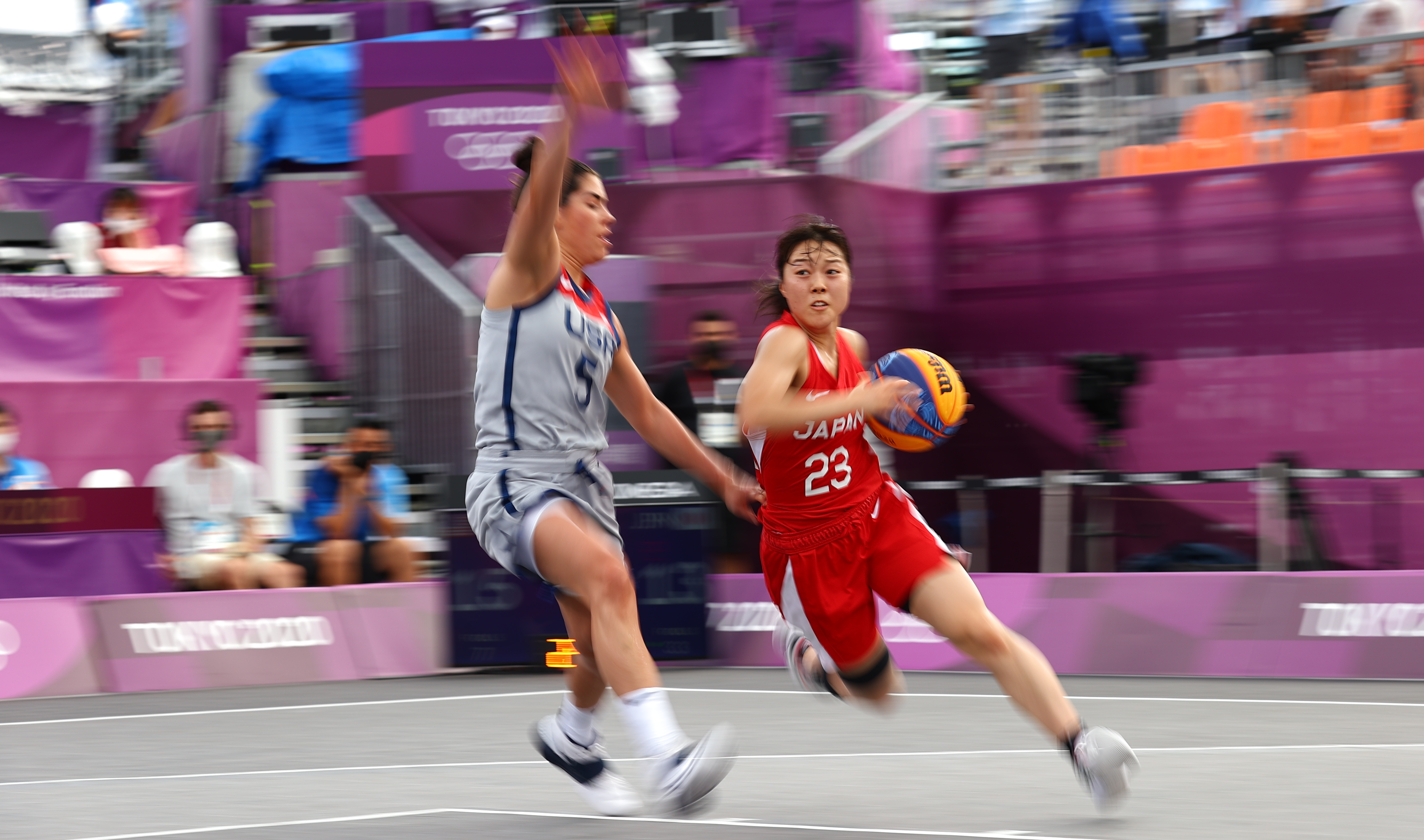 Tokyo 2020 Olympics - Basketball 3x3 - Women - Pool A - United States v Japan - Aomi Urban Sports Park, Tokyo, Japan - July 27, 2021. Mai Yamamoto of Japan in action with Kelsey Plum of the United States during a match. REUTERS/Andrew Boyers