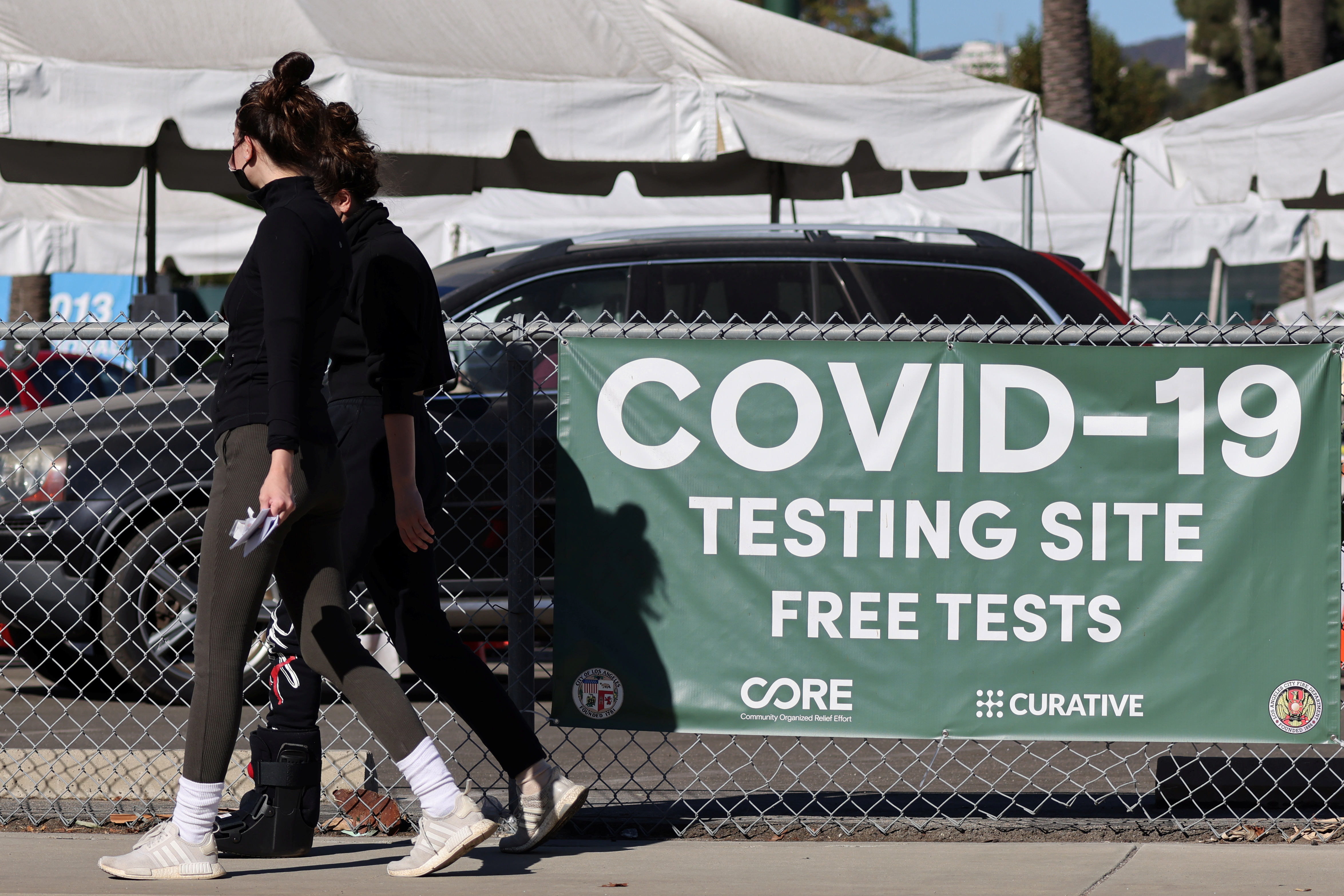 Women walk past a novel coronavirus testing site in Los Angeles, California, U.S., December 1, 2020. REUTERS/Lucy Nicholson