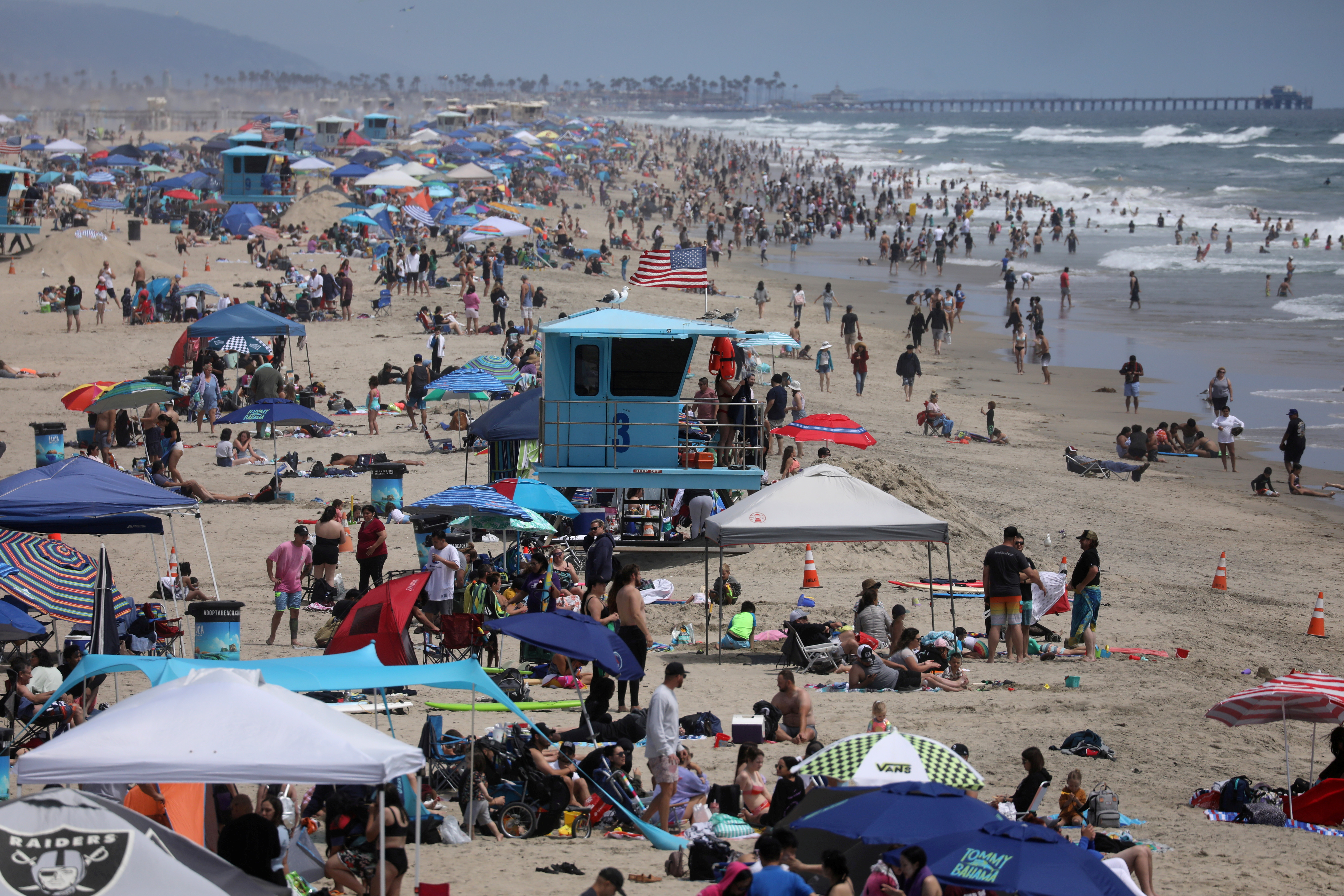 People flock to the beach to enjoy the Memorial Day long weekend, in Santa Monica, California, U.S. May 30, 2021. REUTERS/David Swanson