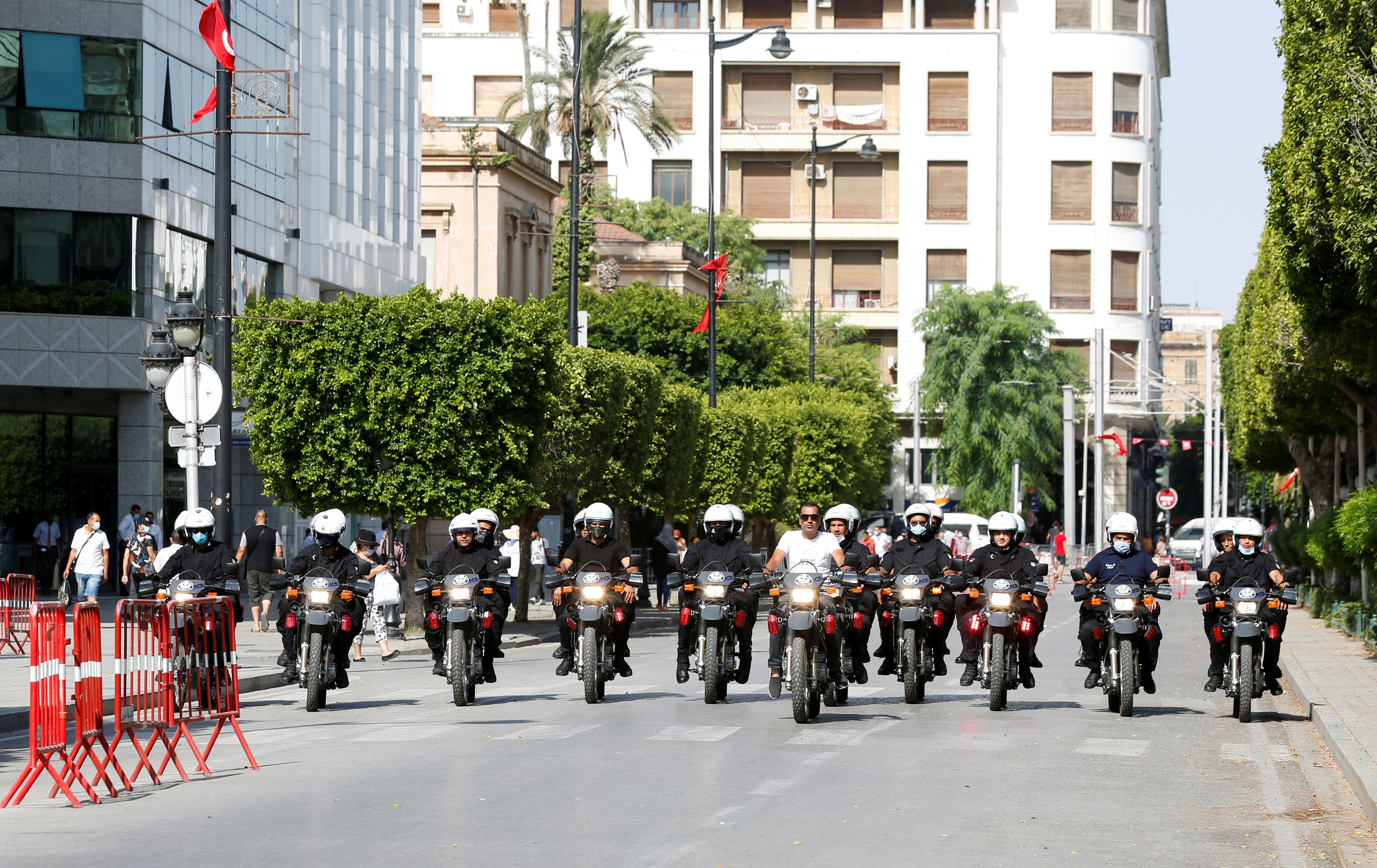 Police officers patrol a street in Tunis, Tunisia, July 28, 2021.  REUTERS/Zoubeir Souissi