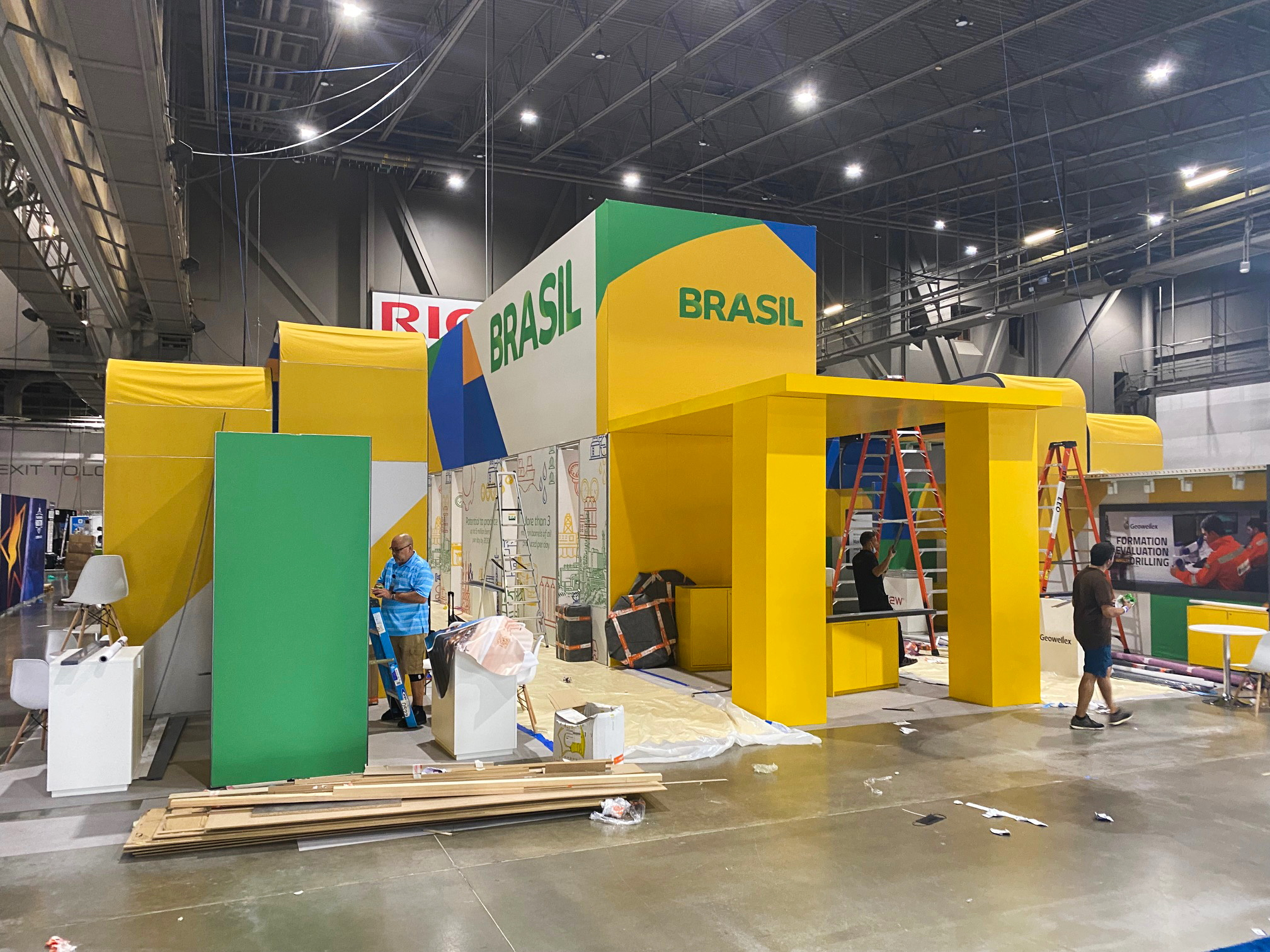 Workers assemble an exhibit booth for Brazil to showcase its offshore oil production at the Offshore Technology Conference in Houston, Texas, U.S., August 14, 2021. The energy industry showcase opens on Monday. REUTERS/Gary McWilliams