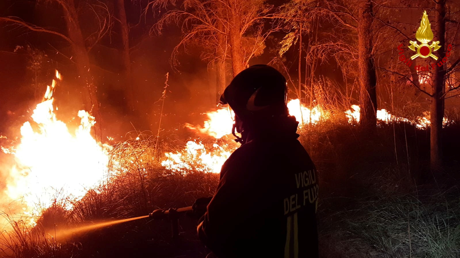 A firefighter battles the flames after a wildfire broke out near the Sicilian village of Erice, Italy July 26, 2021. Vigili del Fuoco/Handout via REUTERS