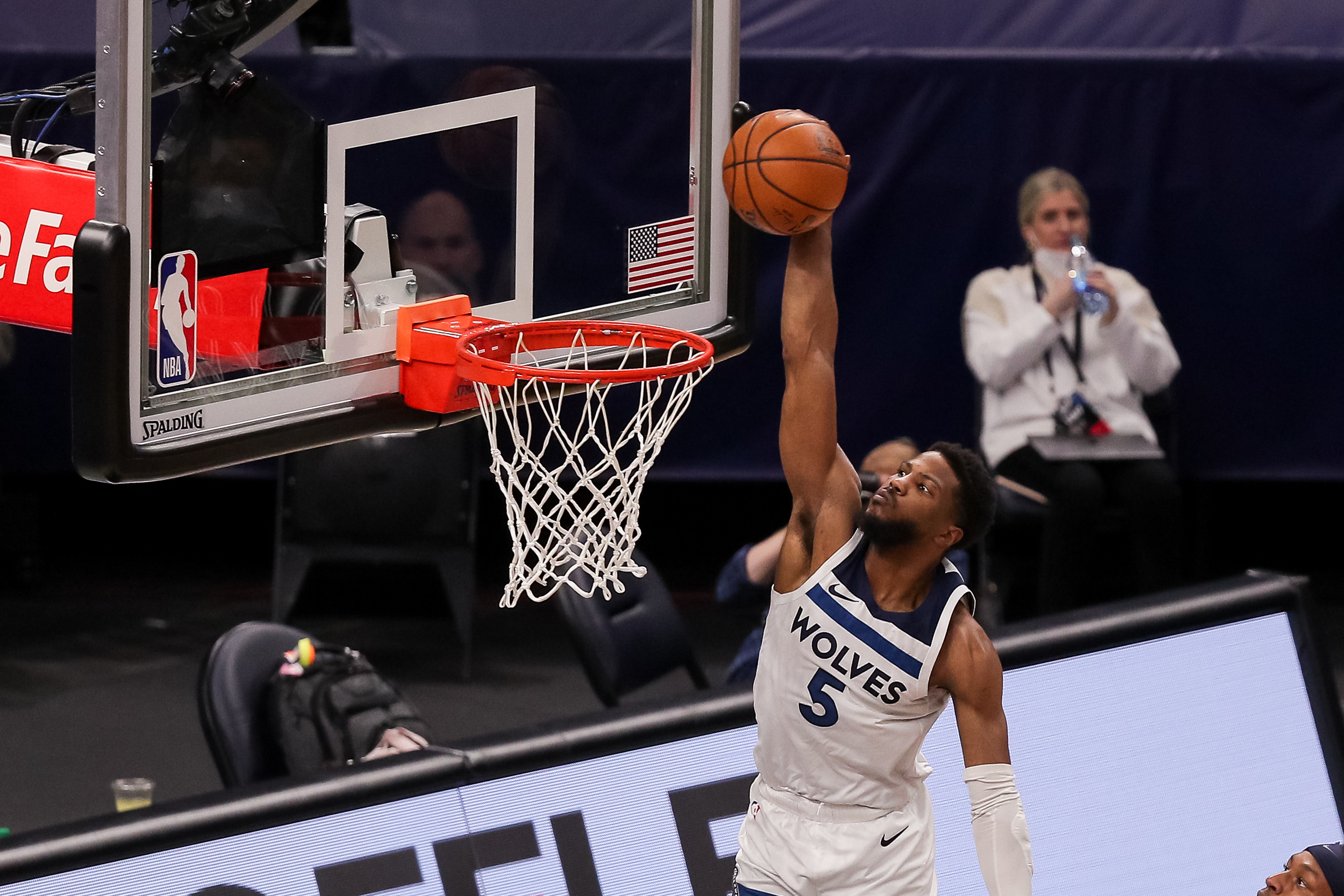 Feb 17, 2021; Minneapolis, Minnesota, USA; Minnesota Timberwolves guard Malik Beasley (5) dunks the ball in the first quarter against the Indiana Pacers at Target Center. Mandatory Credit: Brad Rempel-USA TODAY Sports