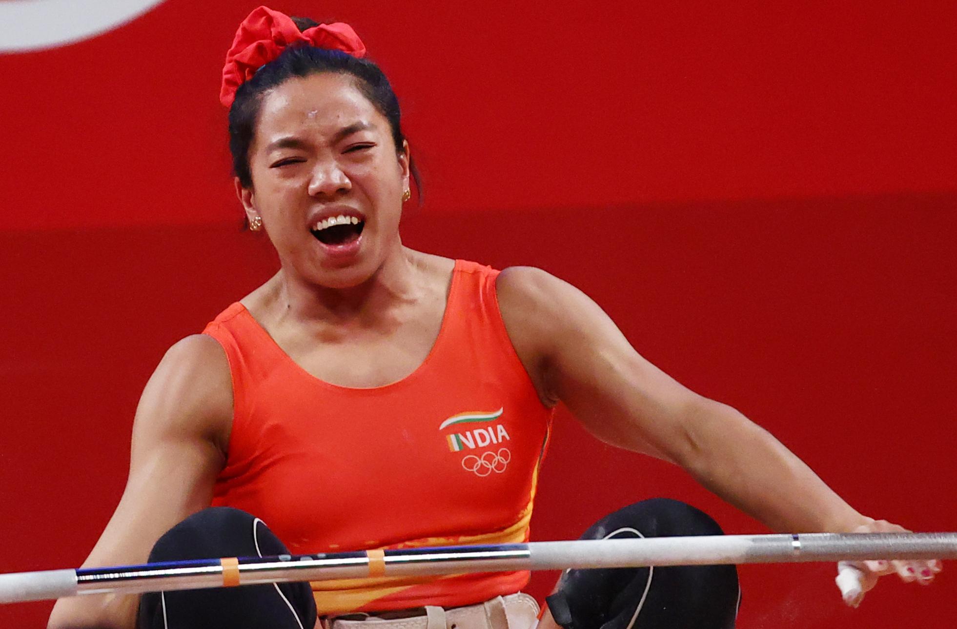 Tokyo 2020 Olympics - Weightlifting - Women's 49kg - Group A - Tokyo International Forum, Tokyo, Japan - July 24, 2021.  Mirabai Chanu Saikhom of India reacts after a lift. REUTERS/Edgard Garrido
