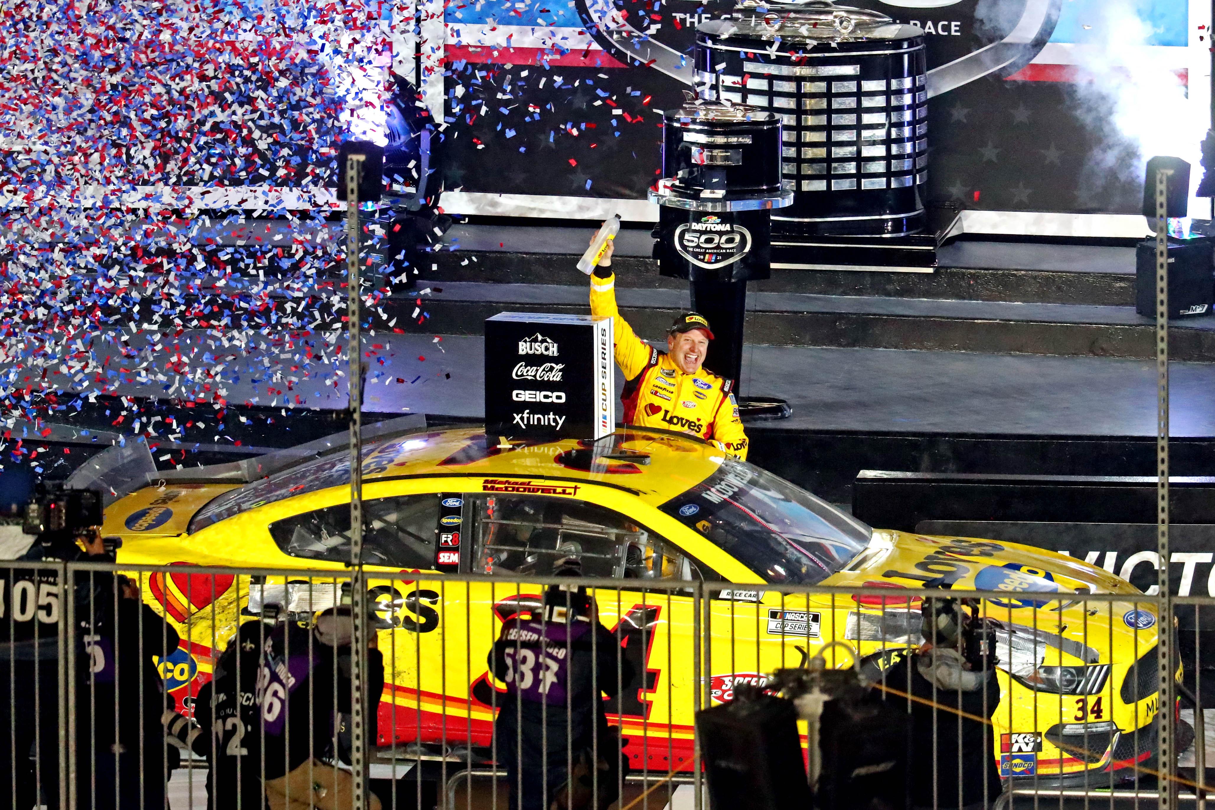 Feb 14, 2021; Daytona Beach, Florida, USA; NASCAR Cup Series driver Michael McDowell (34) celebrates winning the Daytona 500 at Daytona International Speedway. Mark J. Rebilas-USA TODAY Sports