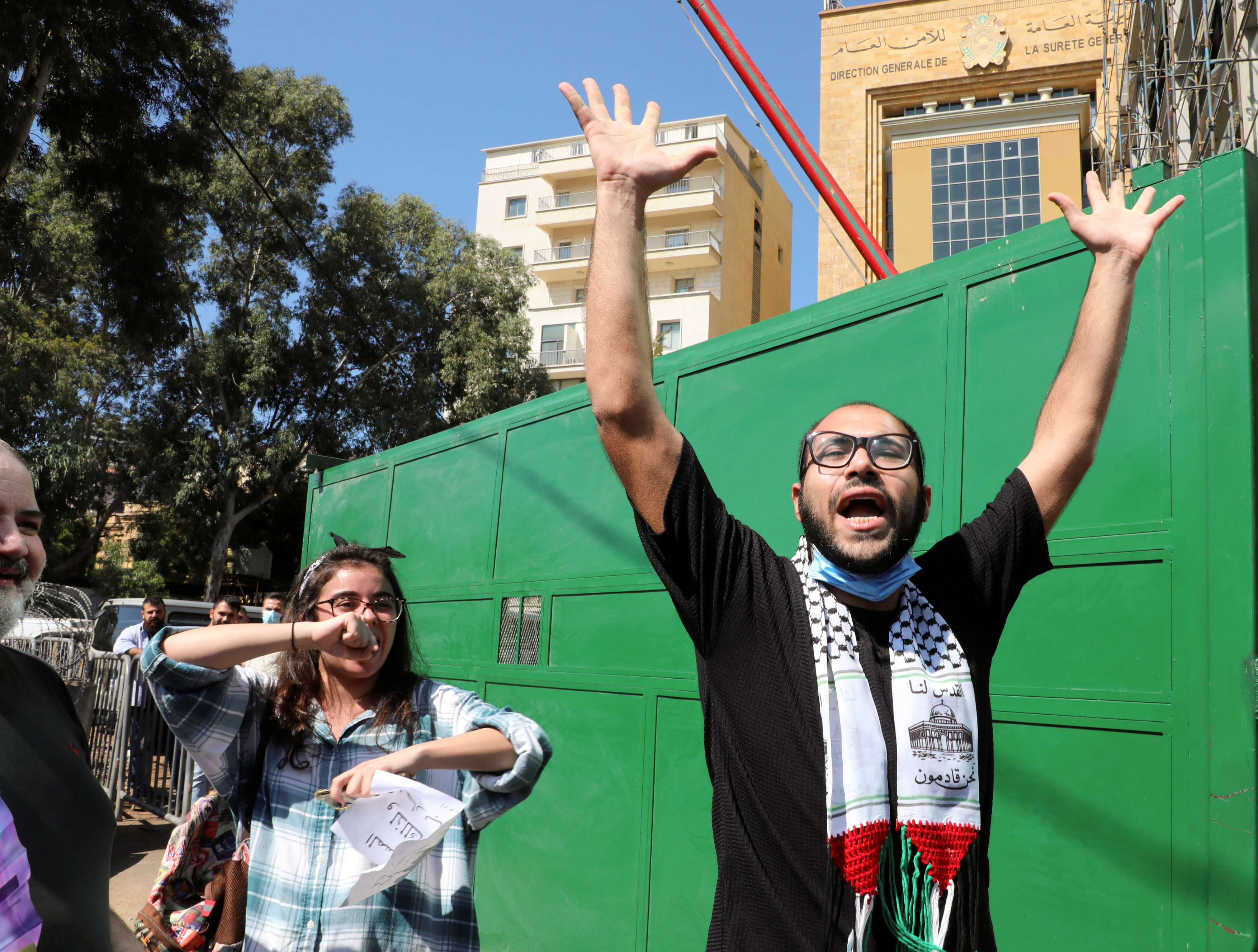 Palestinian director Awad Awad gestures as he leaves after being questioned by the Lebanese General Security, during a protest in support of his play and freedom of expression, in Beirut, Lebanon October 4, 2021. REUTERS/Mohamed Azakir