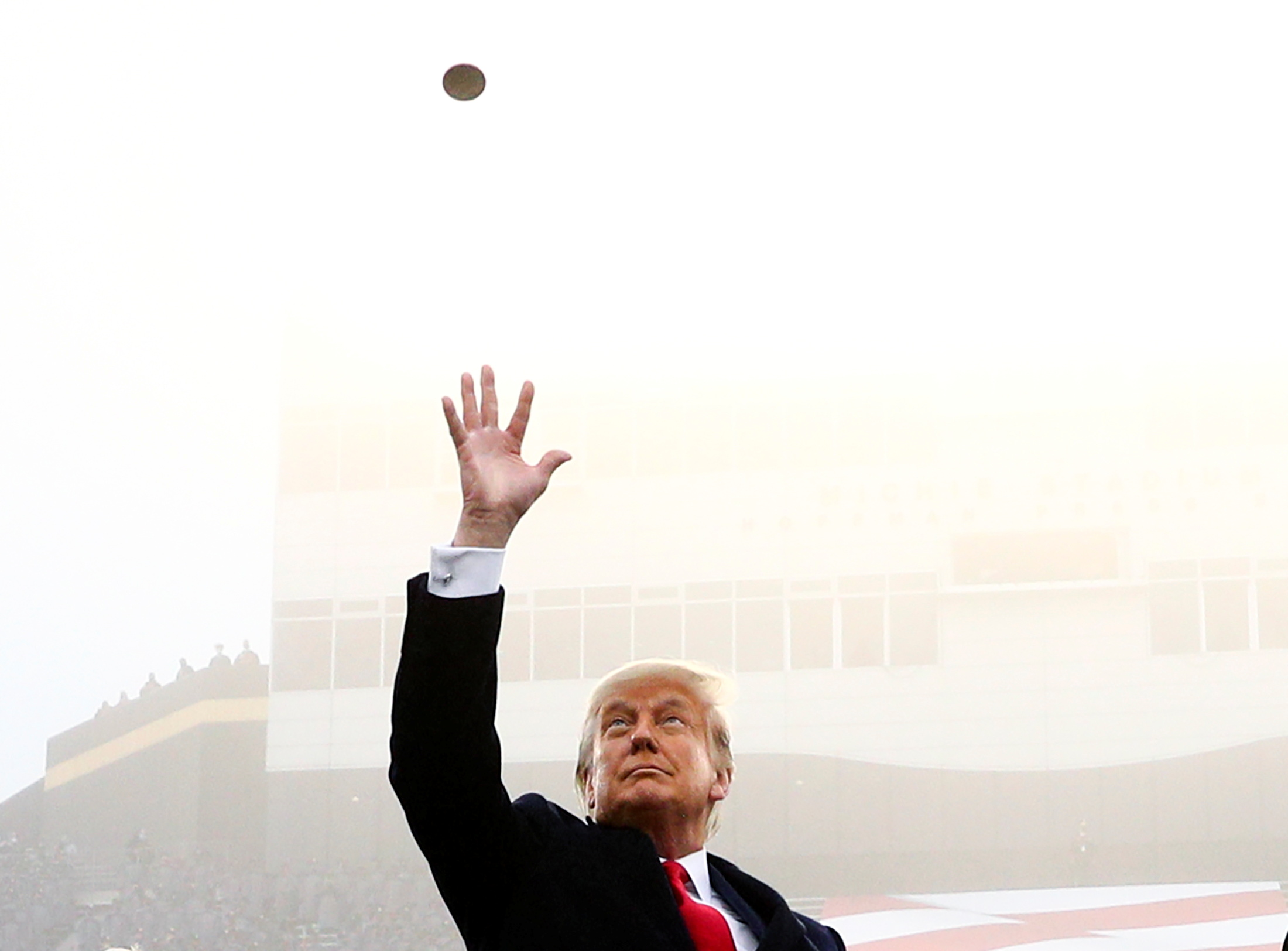 U.S. President Trump participates in a pre-game coin toss ahead of the annual Army-Navy collegiate football game at Michie Stadium, in West Point, New York, U.S., December 12, 2020. REUTERS/Tom Brenner