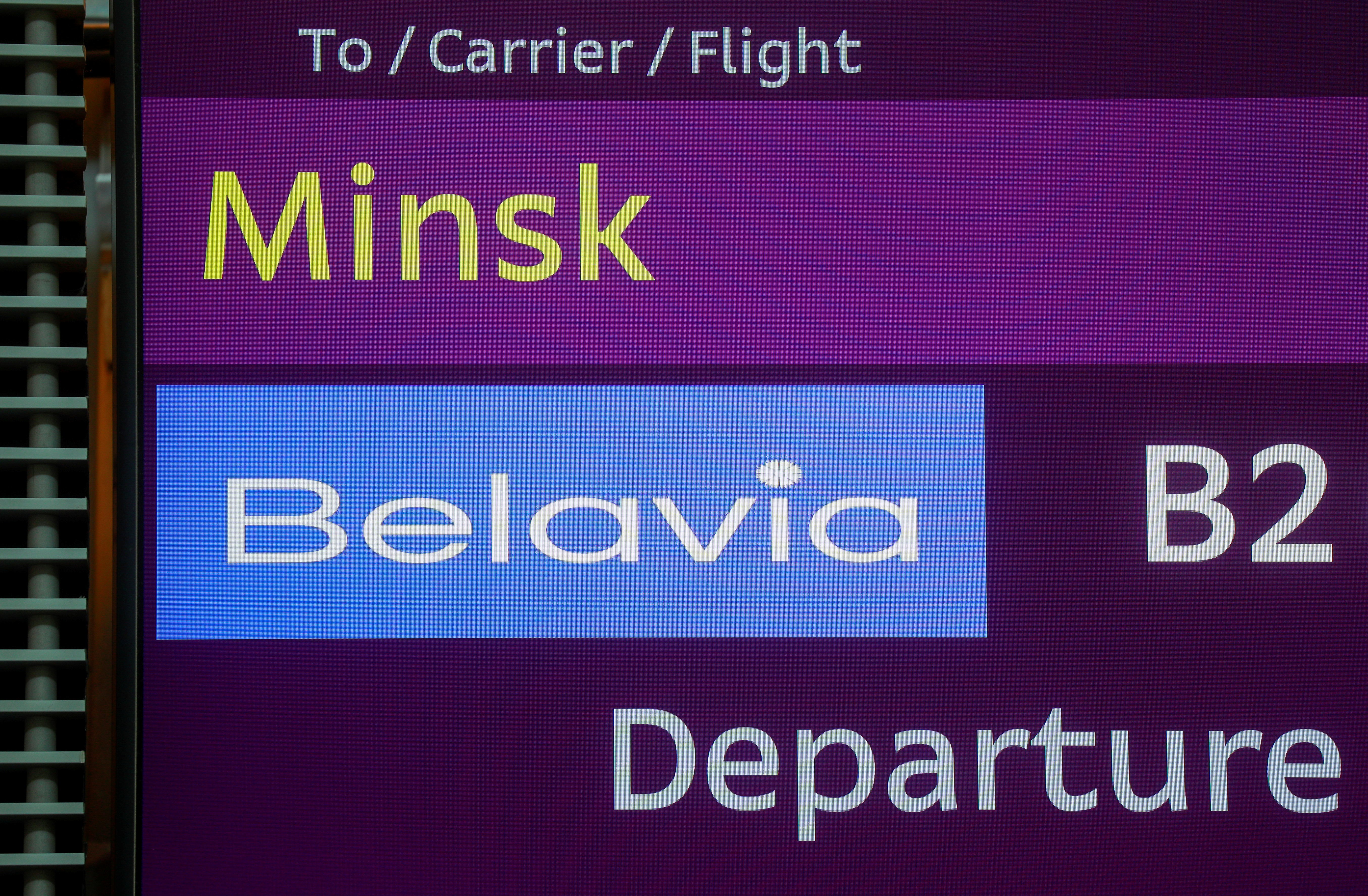 A view shows an information board during a check-in for a flight of Belavia Belarusian Airlines heading to Minsk, the last one before Ukraine stops air travel with Belarus following the arrest of dissident journalist Roman Protasevich, at Boryspil International Airport outside Kyiv, Ukraine May 25, 2021. REUTERS/Valentyn Ogirenko