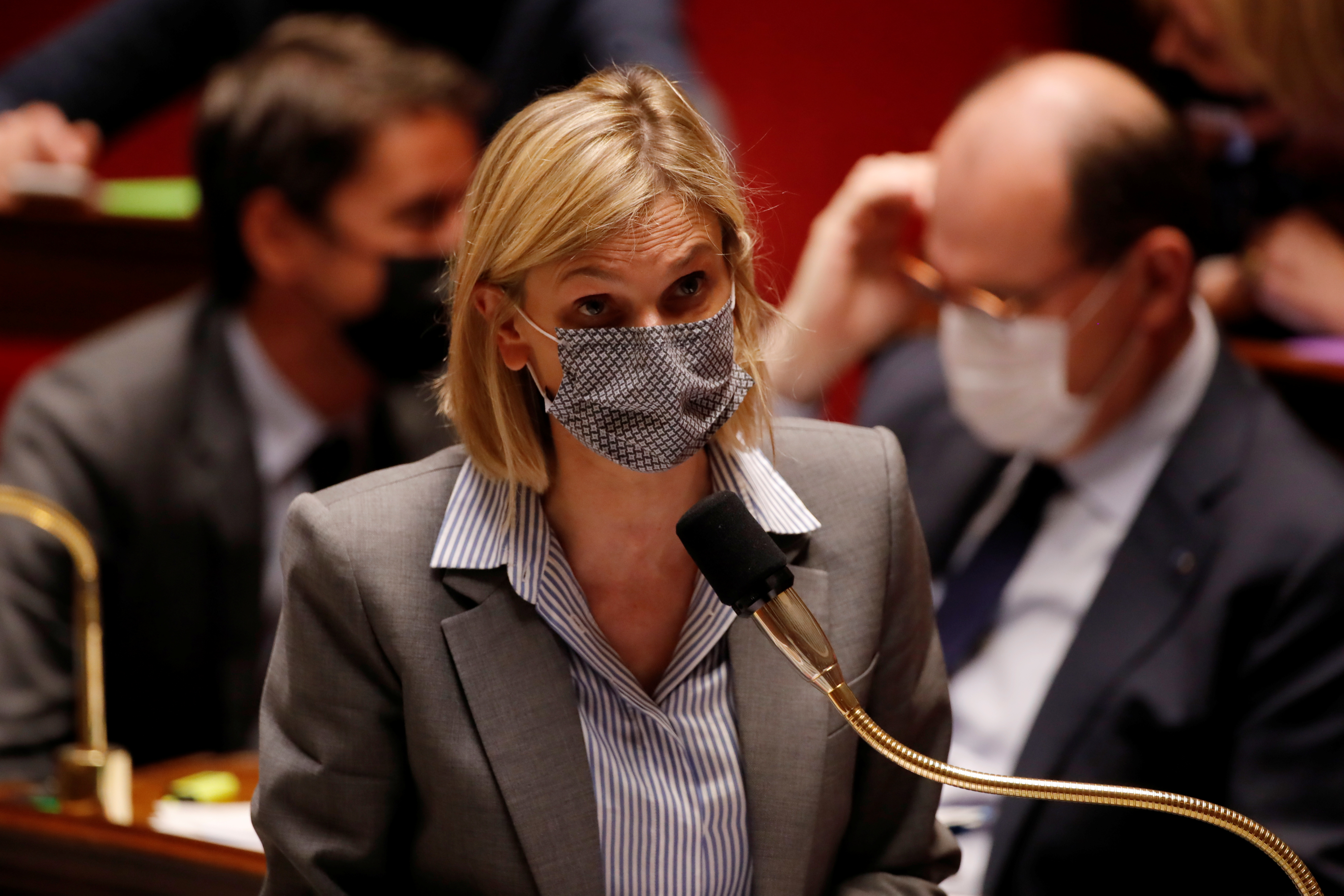 French Junior Industry Minister Agnes Pannier-Runacher, wearing a protective face mask, speaks during the questions to the government session before a final vote on controversial climate change bill at the National Assembly in Paris, France, May 4, 2021. REUTERS/Sarah Meyssonnier