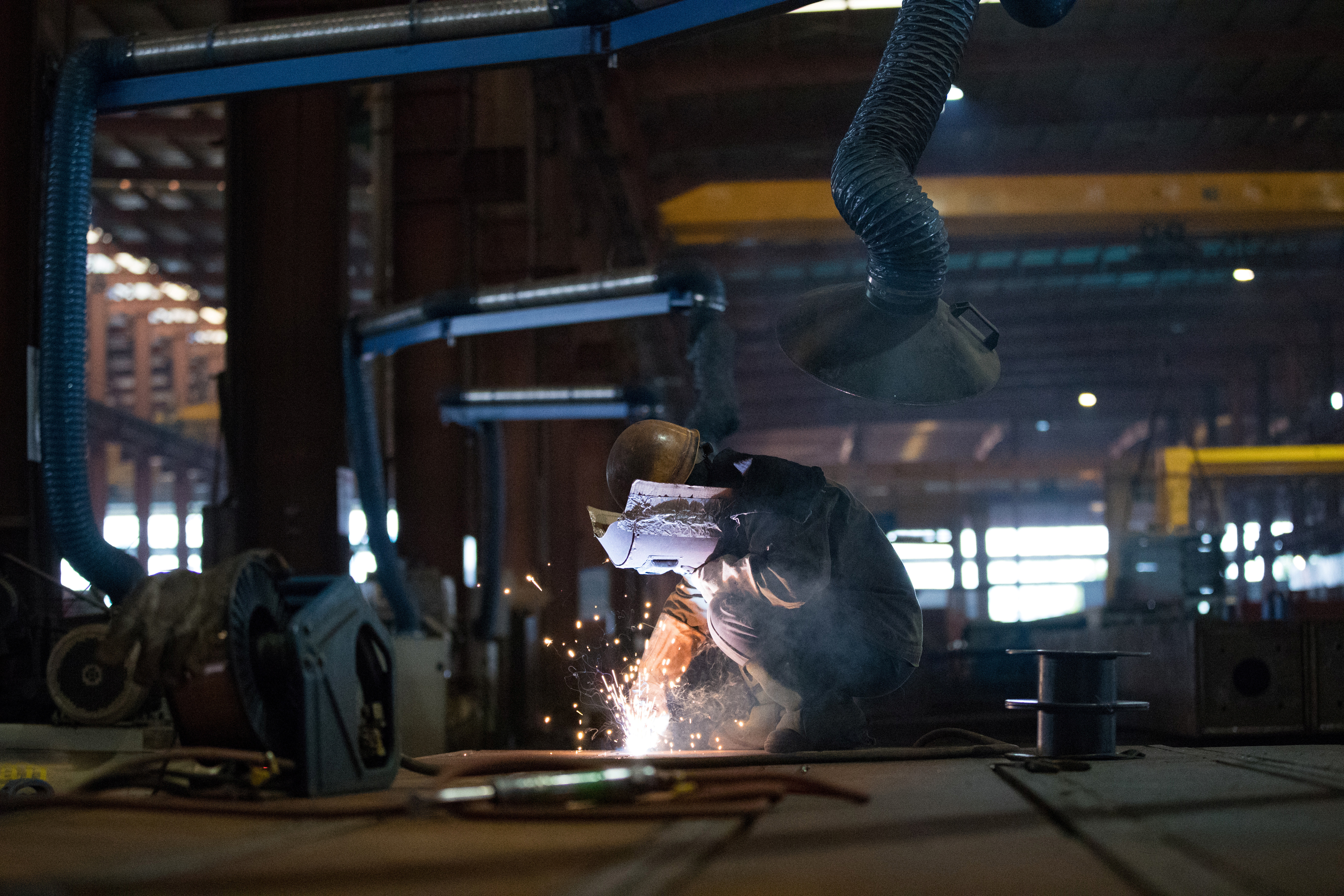 An employee works at a steel processing production line at a factory in Hefei, Anhui province, China February 21, 2020. China Daily via REUTERS