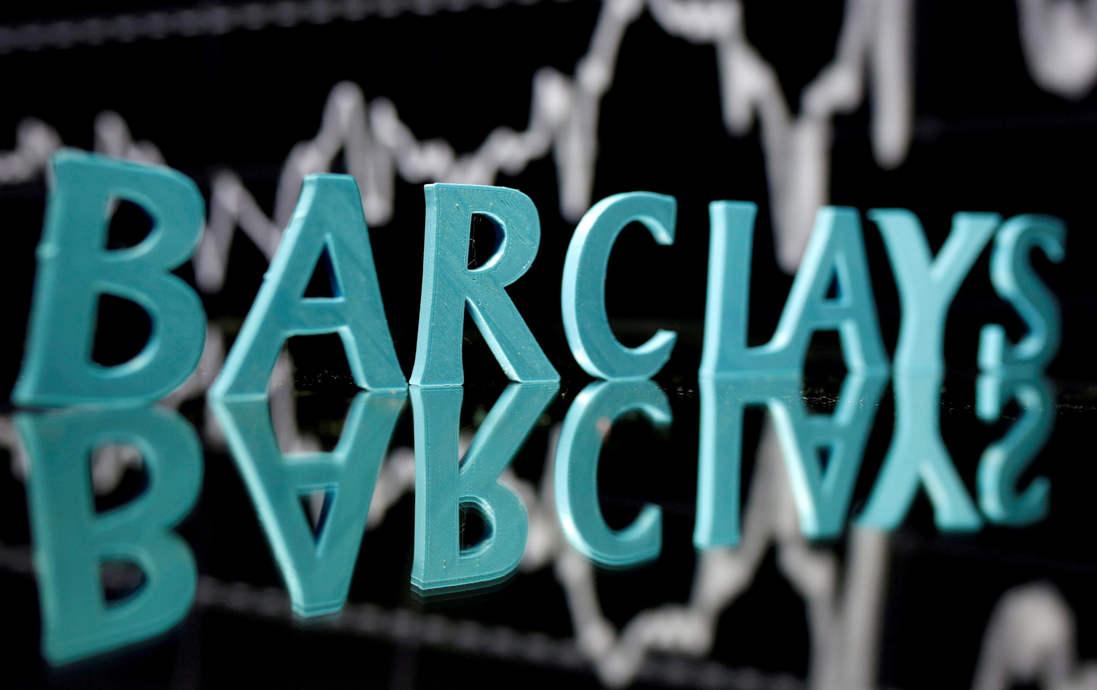 The Barclays logo is seen in front of displayed stock graph in this illustration taken June 21, 2017. REUTERS/Dado Ruvic/Illustration/File Photo