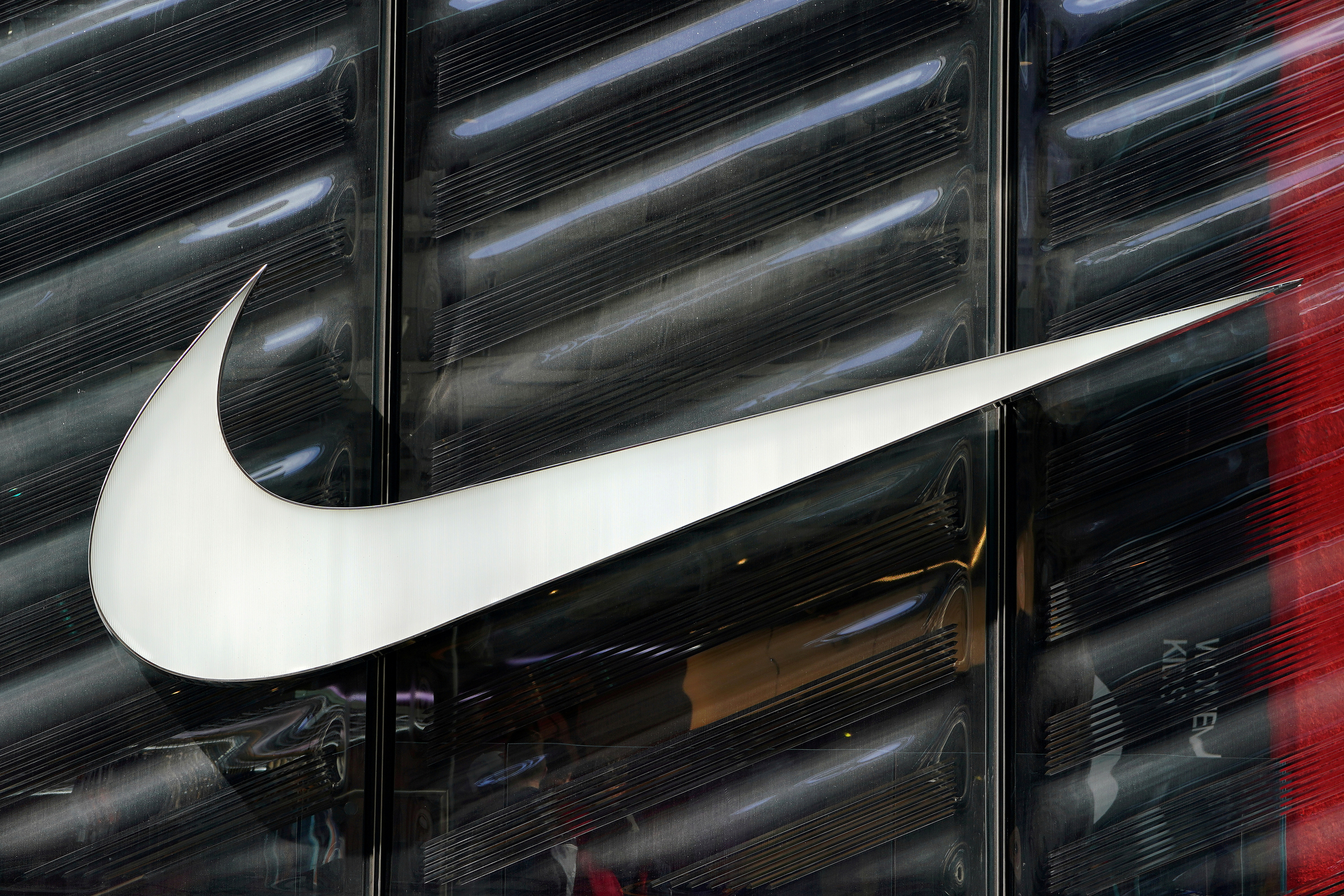 The Nike swoosh logo is seen outside the store on 5th Ave in New York, New York, U.S., March 19, 2019.   REUTERS/Carlo Allegri/File Photo