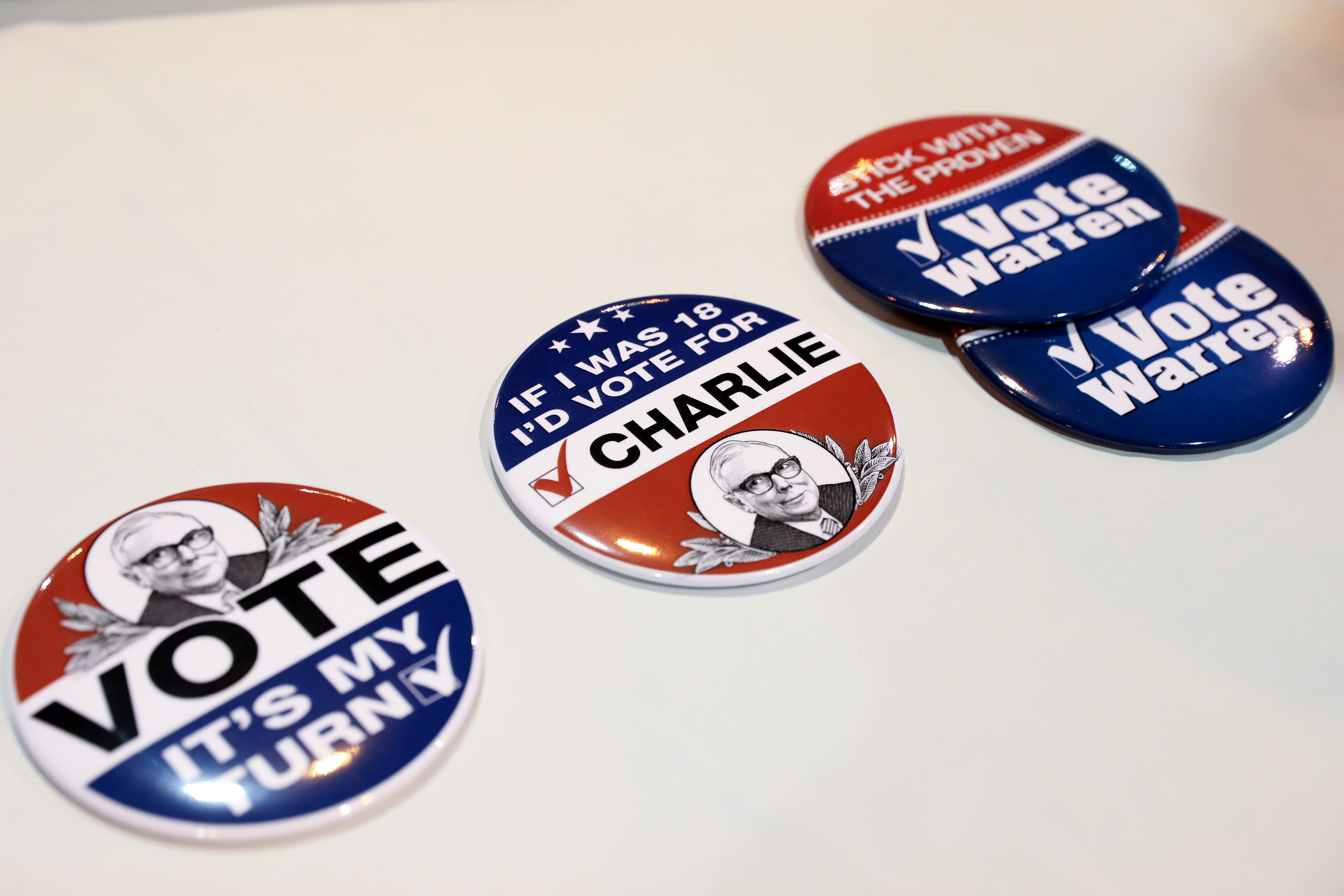 Buttons in a mock campaign to elect Berkshire Hathaway Vice Chairman Charlie Munger as Chairman are pictured at the annual Berkshire Hathaway shareholder meeting in Omaha, Nebraska, U.S., May 4, 2019. REUTERS/Scott Morgan