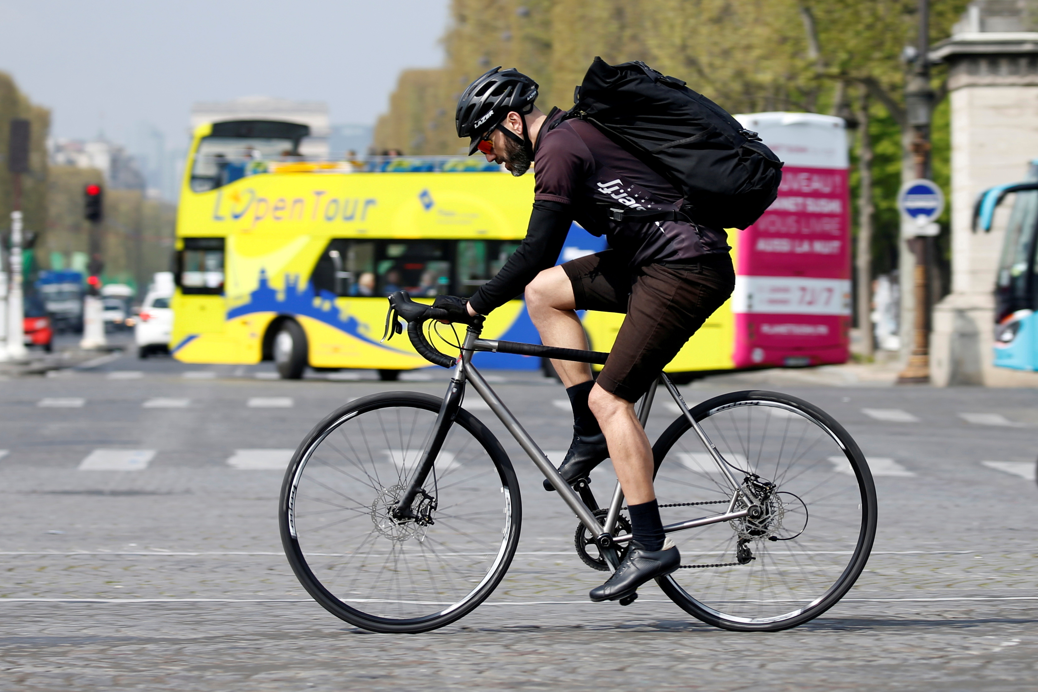 A cycling courier delivers goods, as part of the emerging 'gig economy', in Paris, France, April 4, 2017.  Picture taken April 4, 2017. REUTERS/Charles Platiau