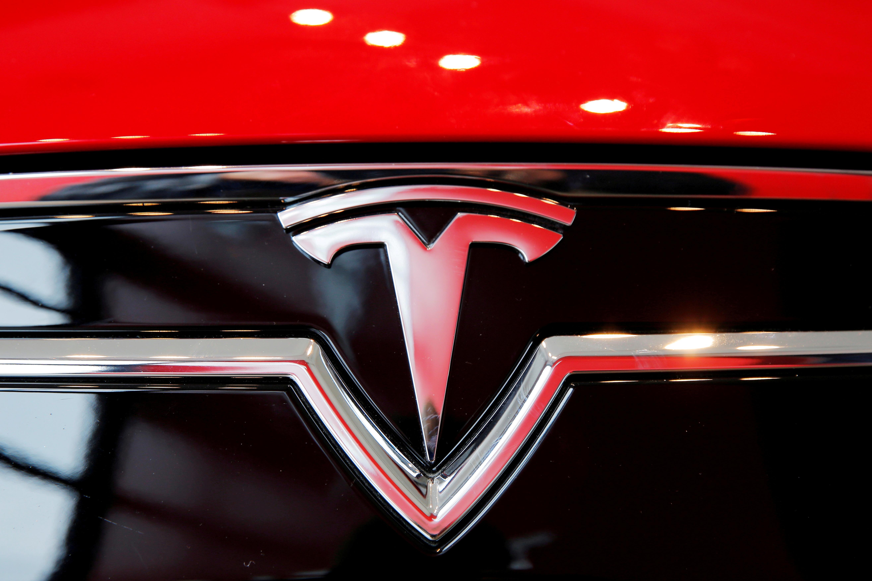 A Tesla logo on a Model S is photographed inside of a Tesla dealership in New York, U.S., April 29, 2016. REUTERS/Lucas Jackson/File Photo