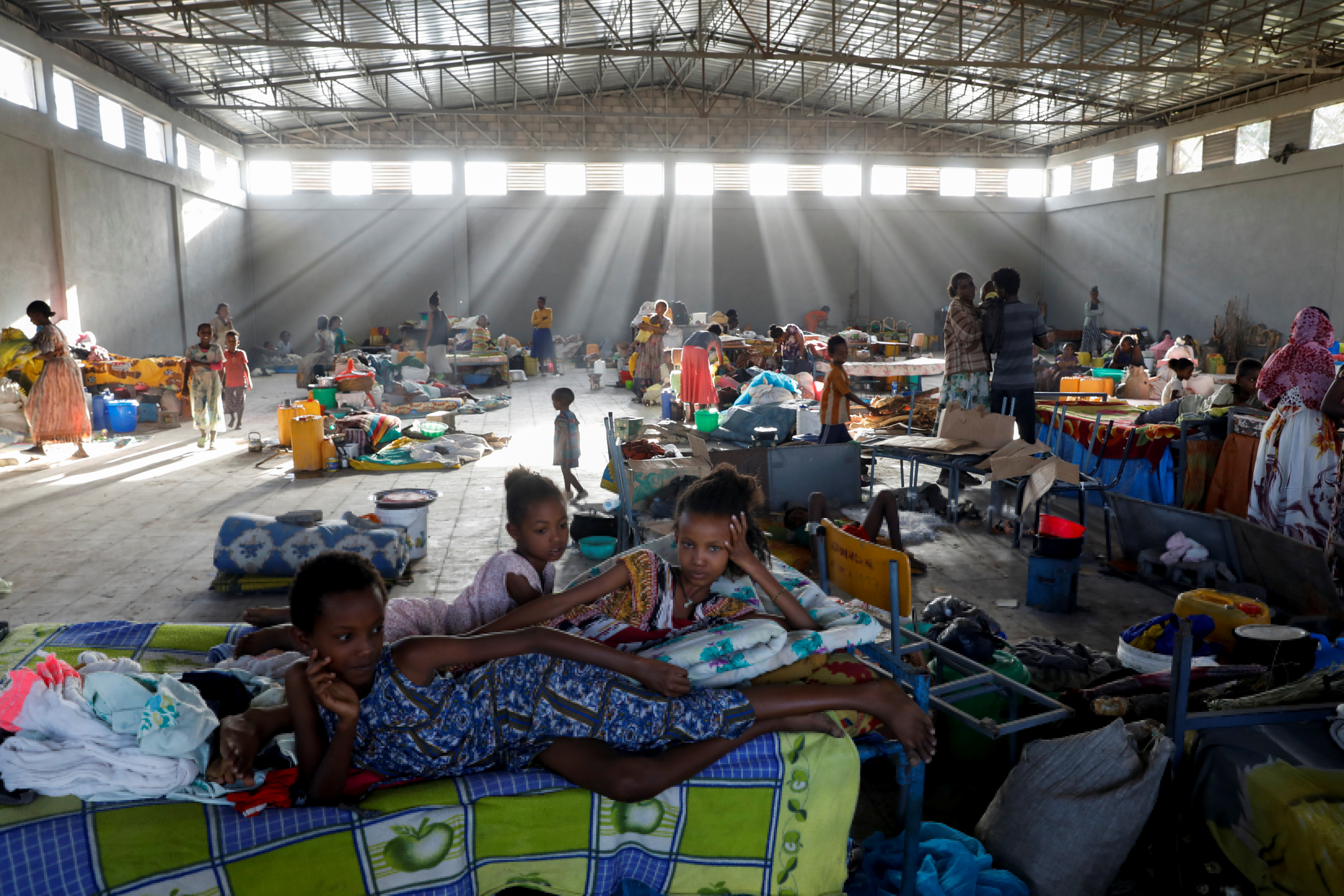 Displaced people are seen at the Shire campus of Aksum University, which was turned into a temporary shelter for people displaced by conflict, in the town of Shire, Tigray region, Ethiopia, March 14, 2021. REUTERS/Baz Ratner     SEARCH
