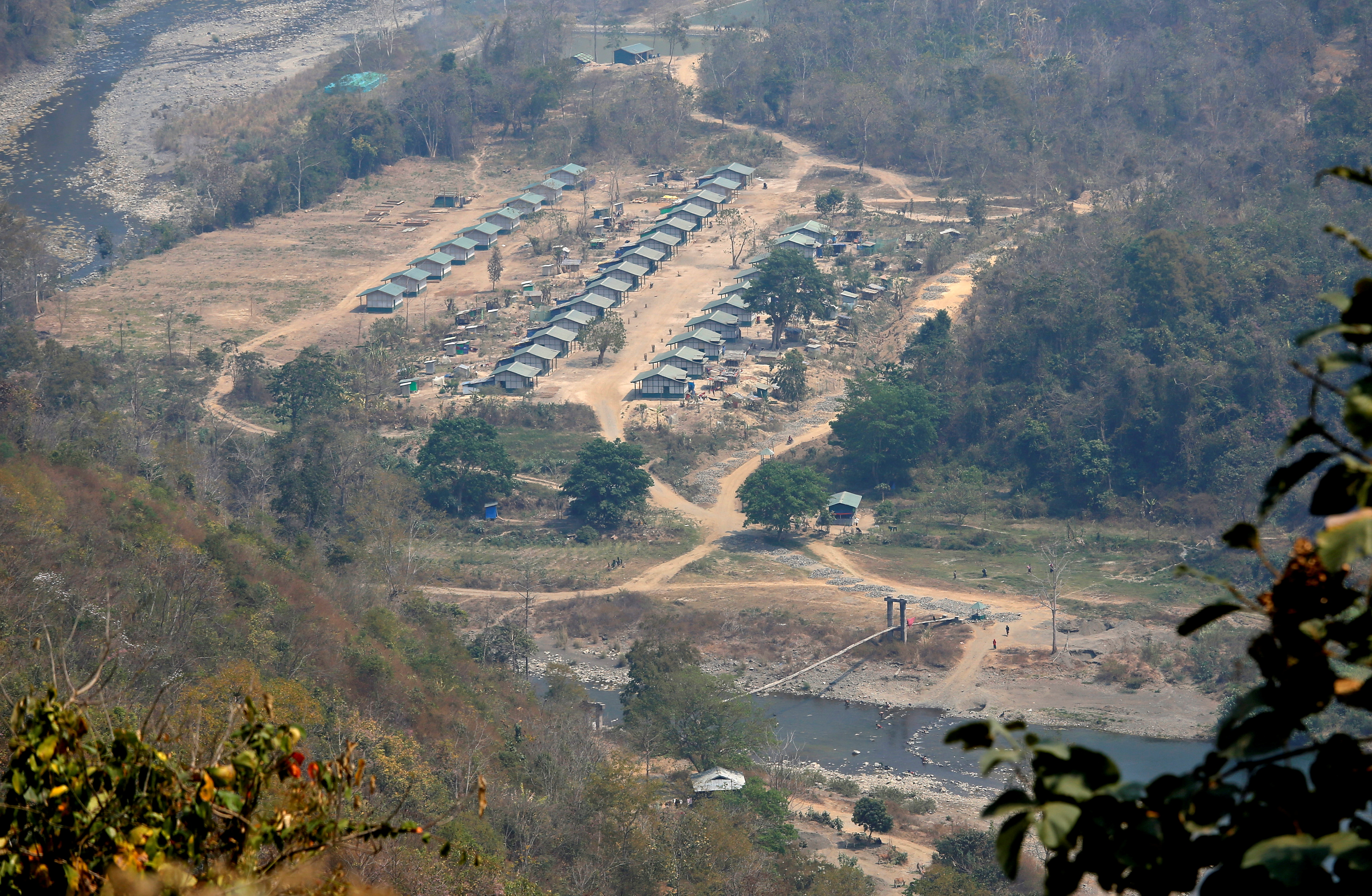 A general view of a camp of the Myanmar ethnic rebel group Chin National Front is seen on the Myanmar side of the India-Myanmar border close to the Indian village of Farkawn in the northeastern state of Mizoram, India, March 13, 2021. Picture taken March 13, 2021. REUTERS/Rupak De Chowdhuri/File Photo