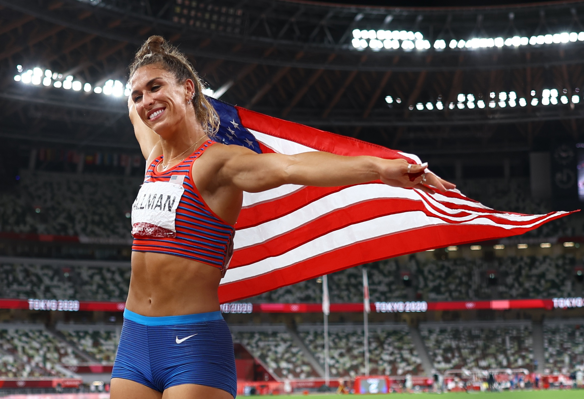 Tokyo 2020 Olympics - Athletics - Women's Discus Throw - Final - Olympic Stadium, Tokyo, Japan - August 2, 2021. Valarie Allman of the United States celebrates with her national flag after winning gold REUTERS/Kai Pfaffenbach
