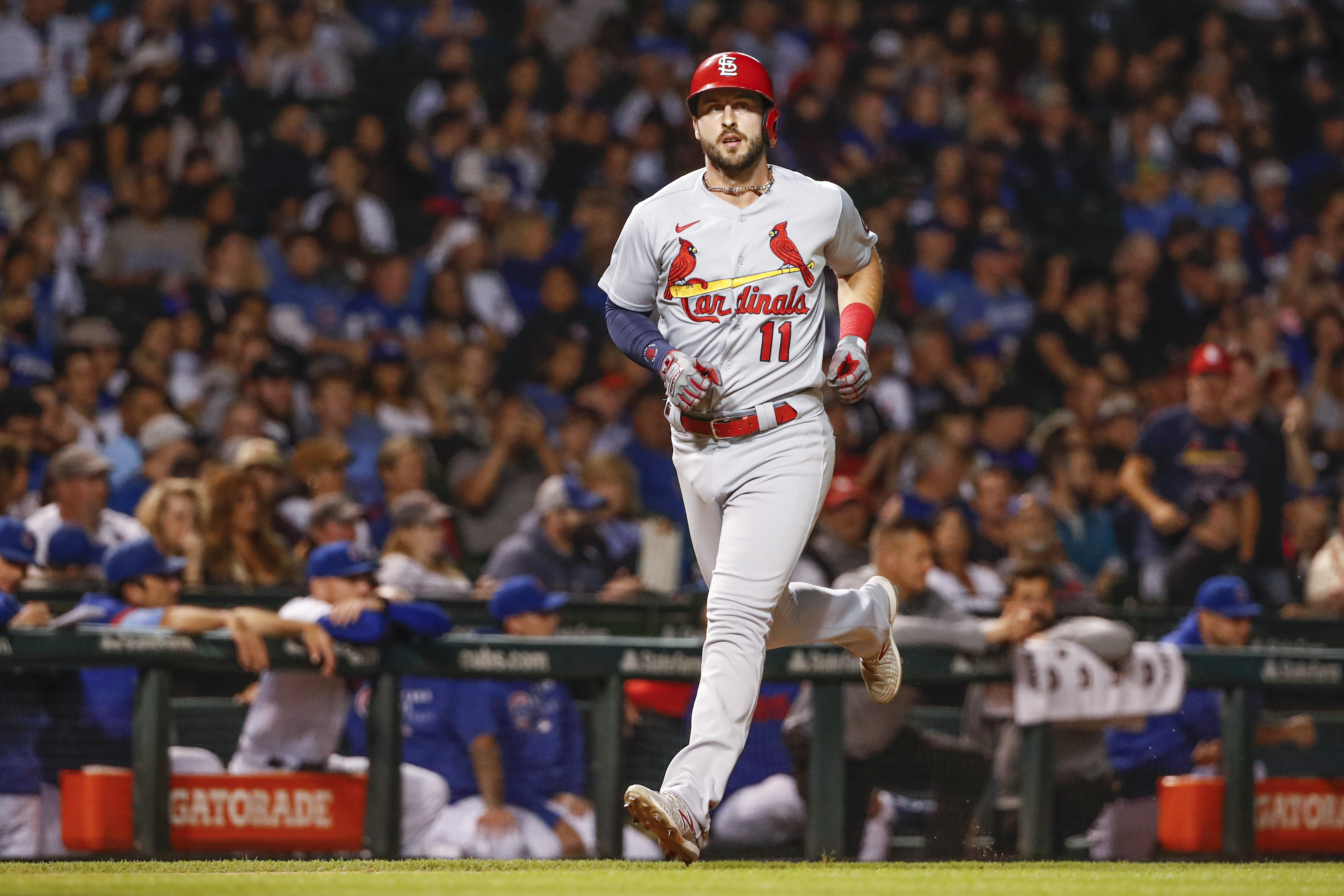 Sep 24, 2021; Chicago, Illinois, USA; St. Louis Cardinals shortstop Paul DeJong (11) crosses home plate after hitting a solo home run against the Chicago Cubs during the third inning of game 2 of a doubleheader at Wrigley Field. Mandatory Credit: Kamil Krzaczynski-USA TODAY Sports