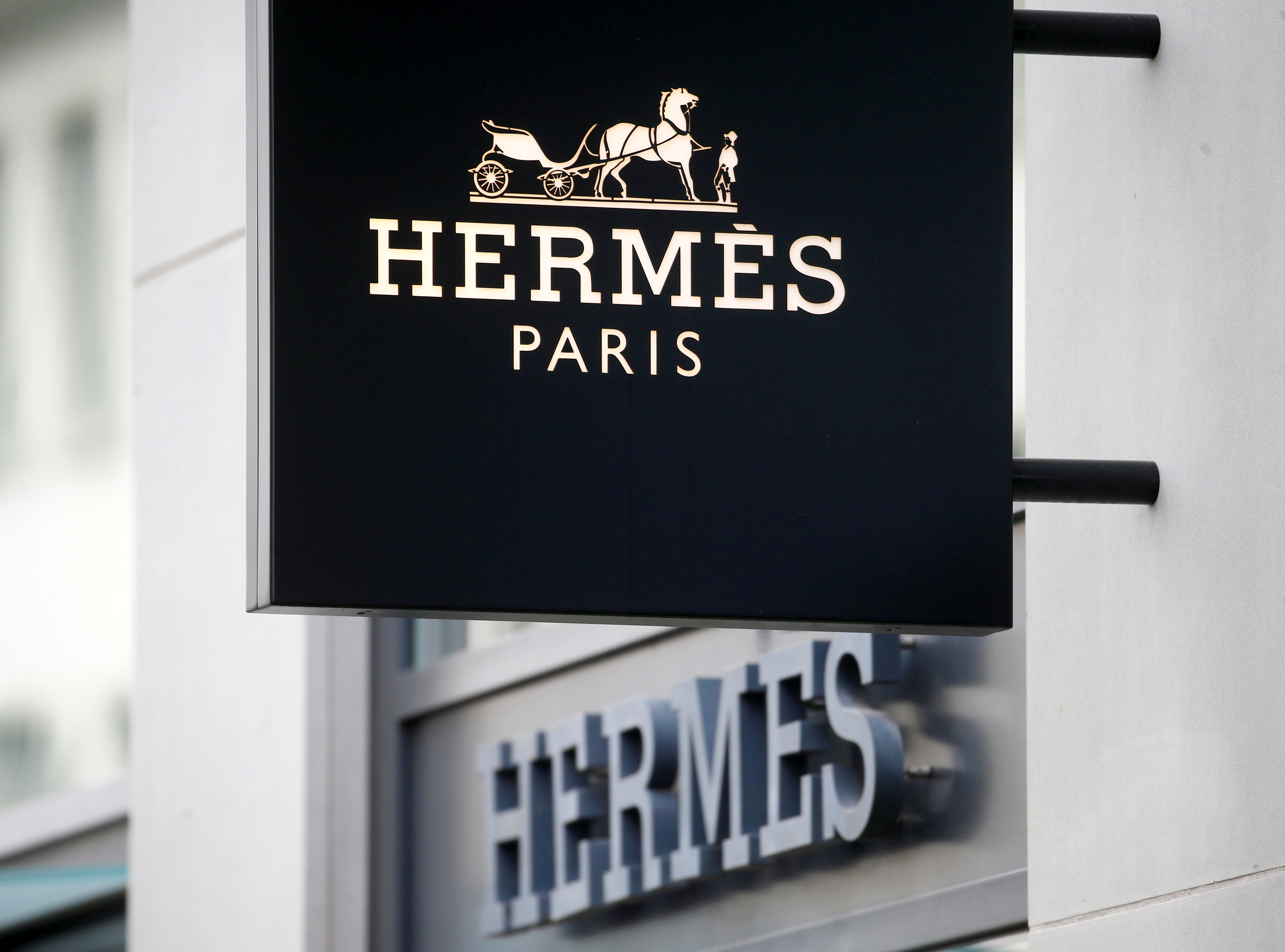 The logo of French luxury group Hermes is seen at a store, as the spread of the coronavirus disease (COVID-19) continues, in Zurich, Switzerland February 17, 2021. REUTERS/Arnd Wiegmann