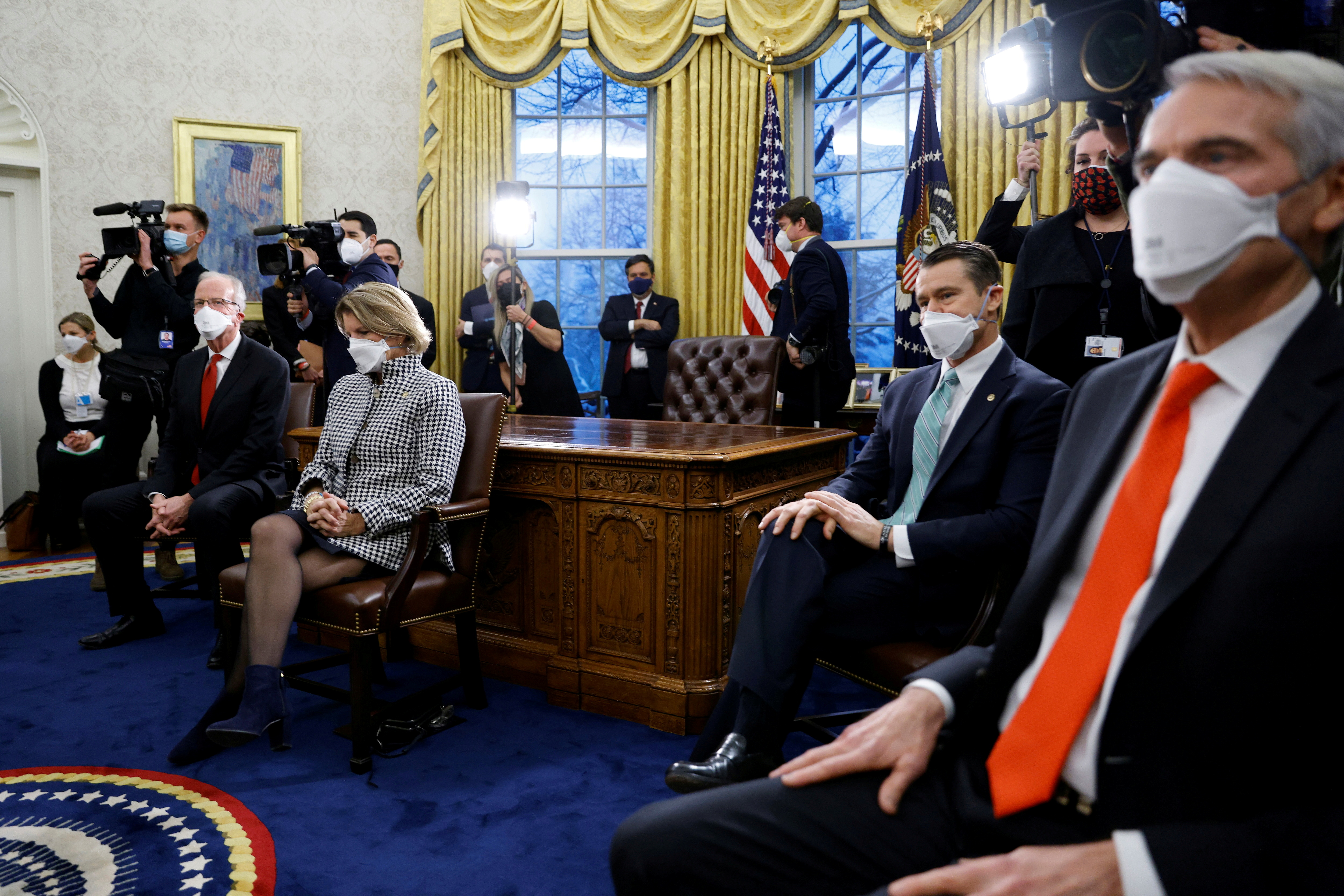 Republican senators look on during a meeting with U.S. President Joe Biden and Vice President Kamala Harris, not pictured, to discuss coronavirus disease (COVID-19) federal aid legislation inside the Oval Office at the White House in Washington, U.S., February 1, 2021. REUTERS/Tom Brenner