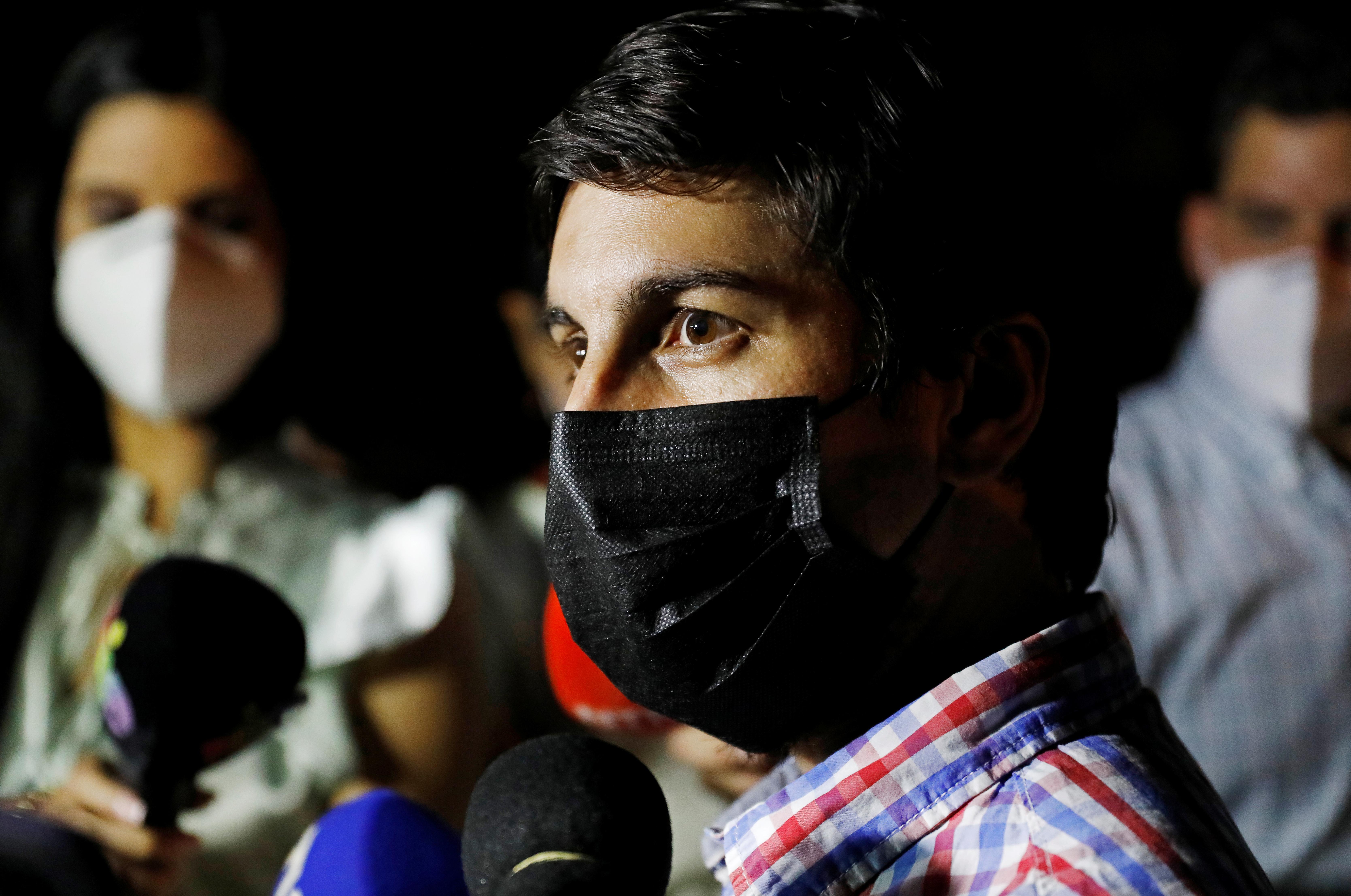 Venezuelan opposition leader Freddy Guevara speaks to the media after leaving