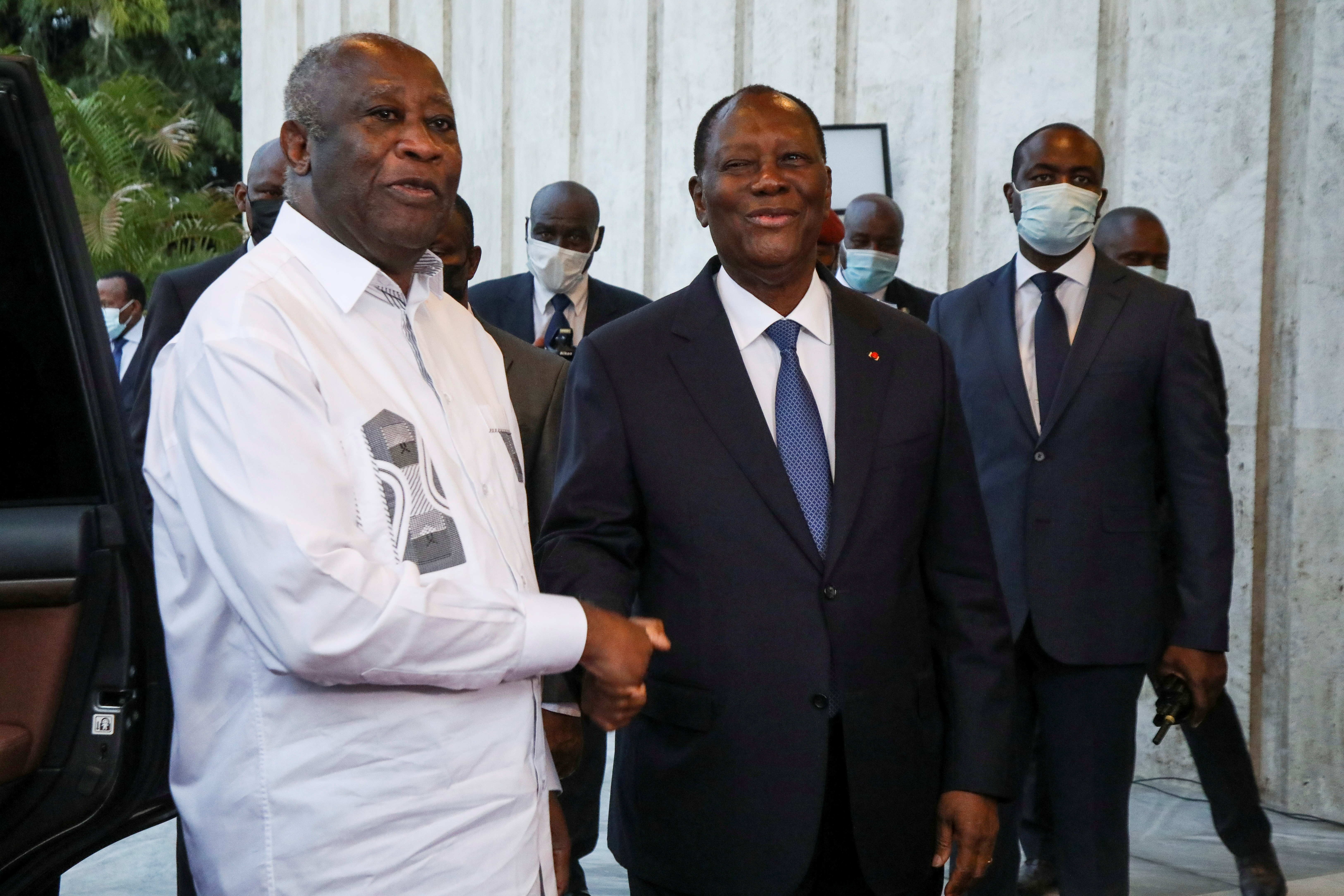 Ivory Coast's President Alassane Ouattara shakes hands with former President Laurent Gbagbo during a meeting at the presidential palace in Abidjan, Ivory Coast July 27, 2021. REUTERS/Luc Gnago