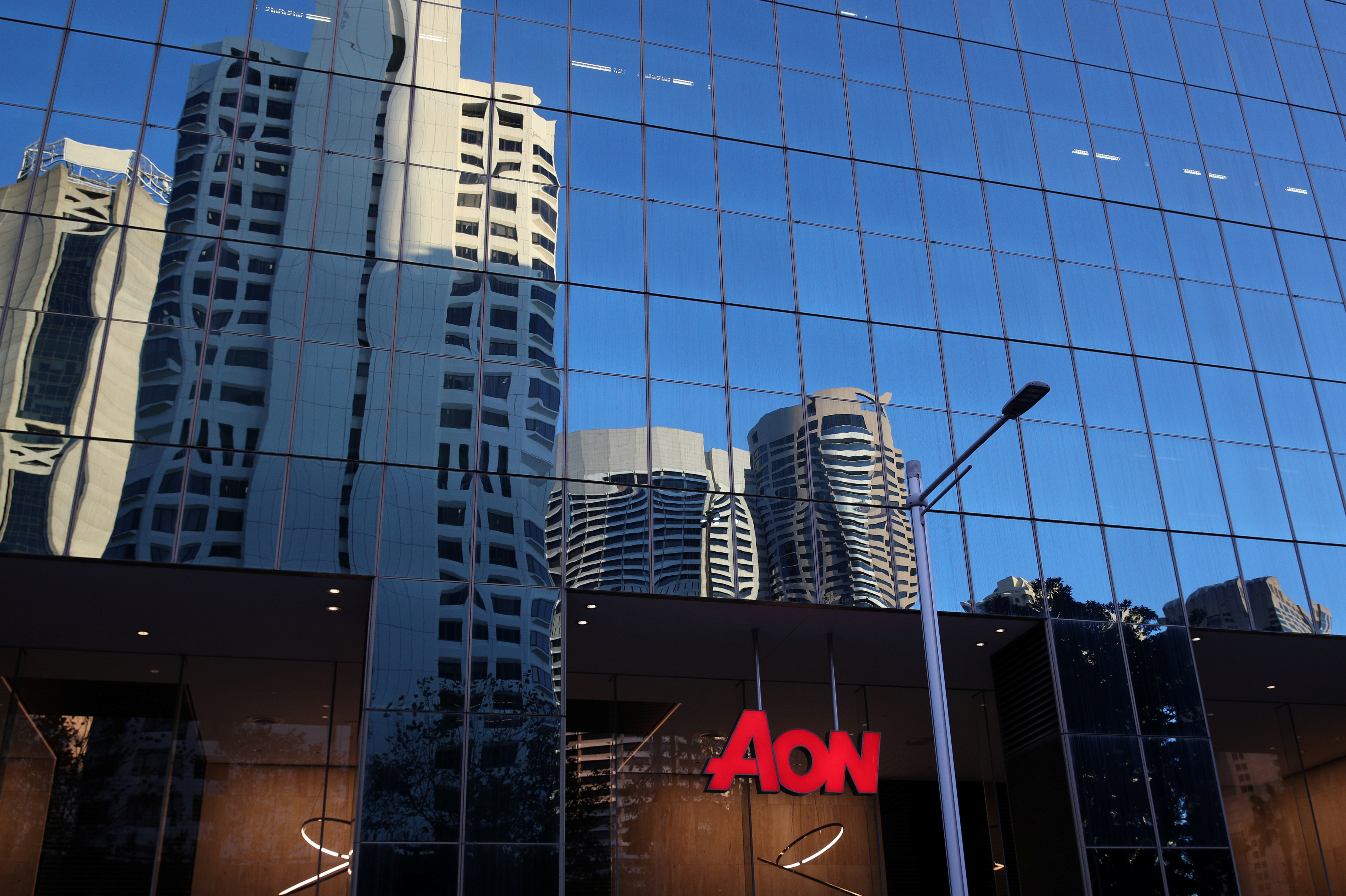 An office building with Aon logo is seen amidst the easing of the coronavirus disease (COVID-19) restrictions in the Central Business District of Sydney, Australia, June 3, 2020.  REUTERS/Loren Elliott