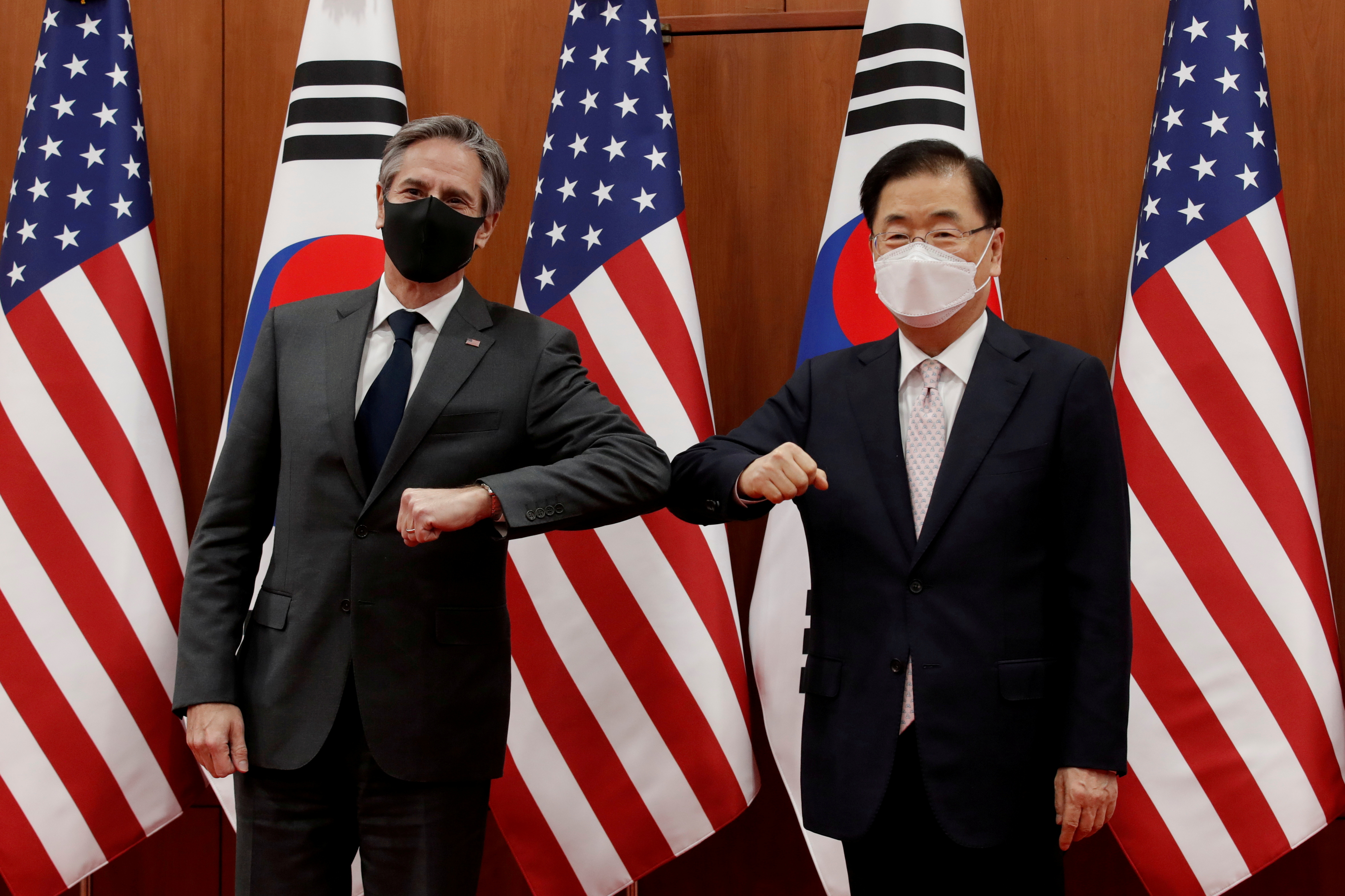 U.S. Secretary of State Antony Blinken, left, and South Korean Foreign Minister Chung Eui-yong pose for the media before their meeting at the Foreign Ministry in Seoul, South Korea March 17, 2021. Lee Jin-man/Pool via REUTERS