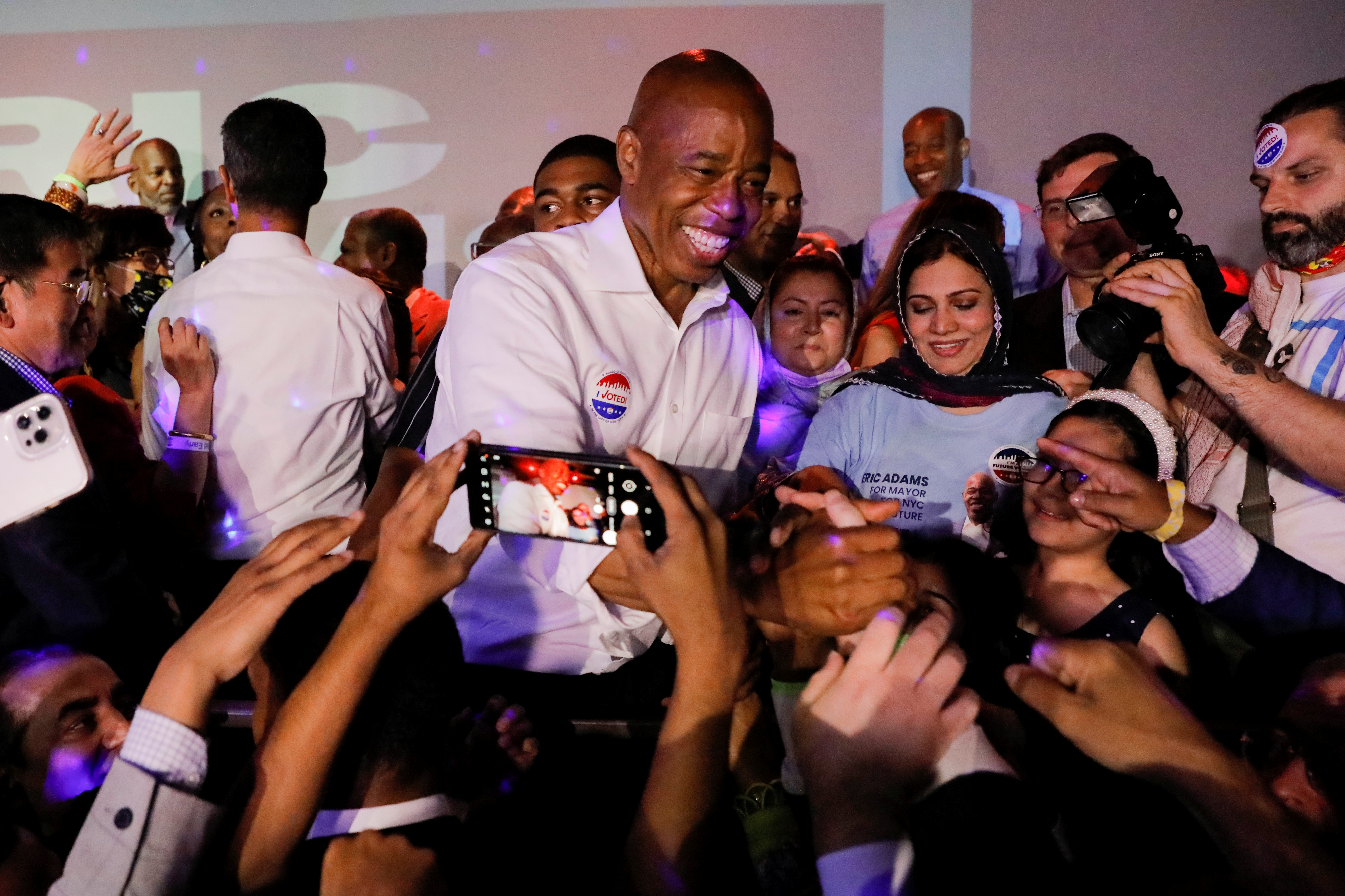 Eric Adams greets supporters at a New York City primary mayoral election night party in New York City, U.S., June 22, 2021. REUTERS/Andrew Kelly