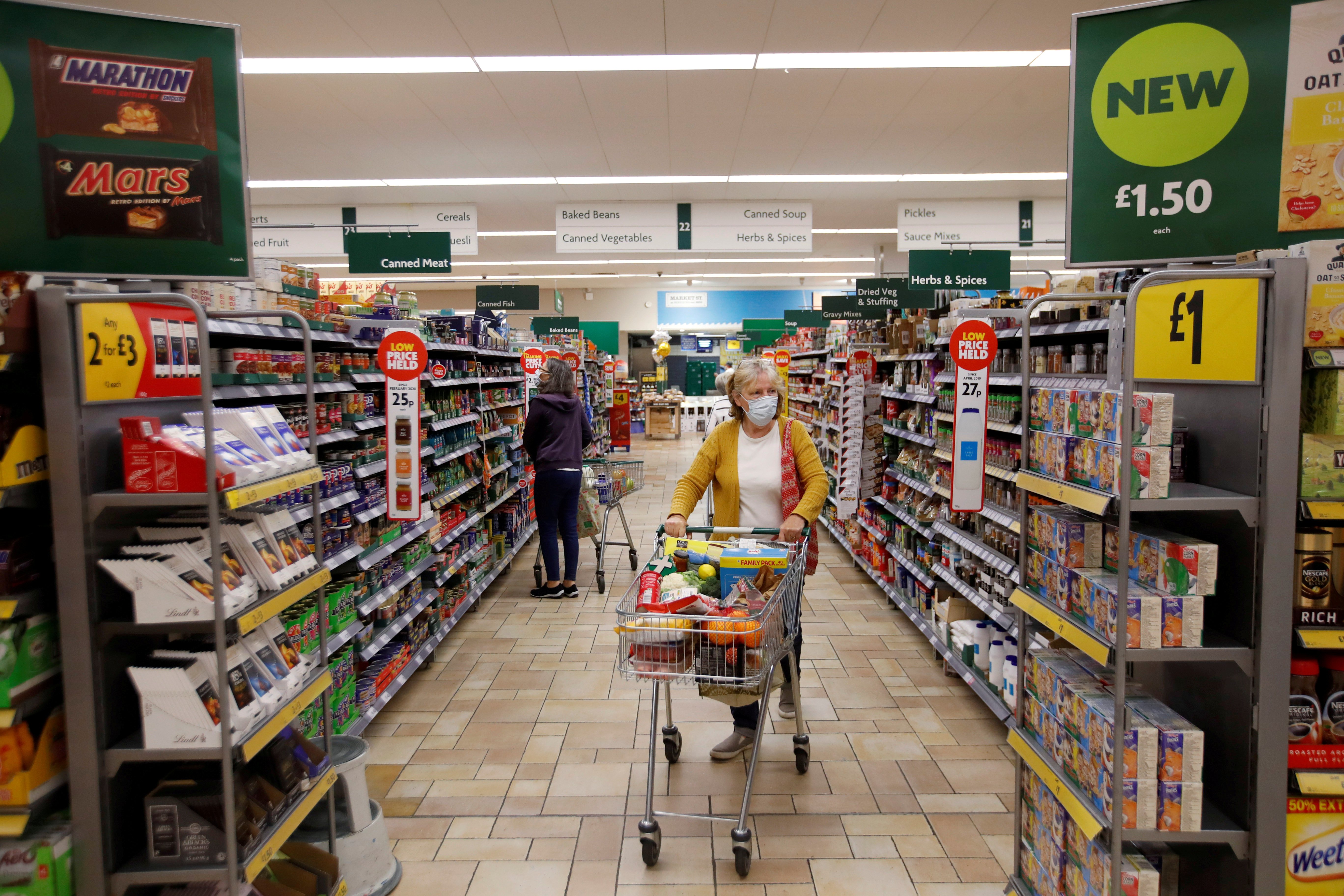 A customer wearing a protective face mask shops at a Morrisons store in St Albans, Britain, September 10, 2020. REUTERS/Peter Cziborra