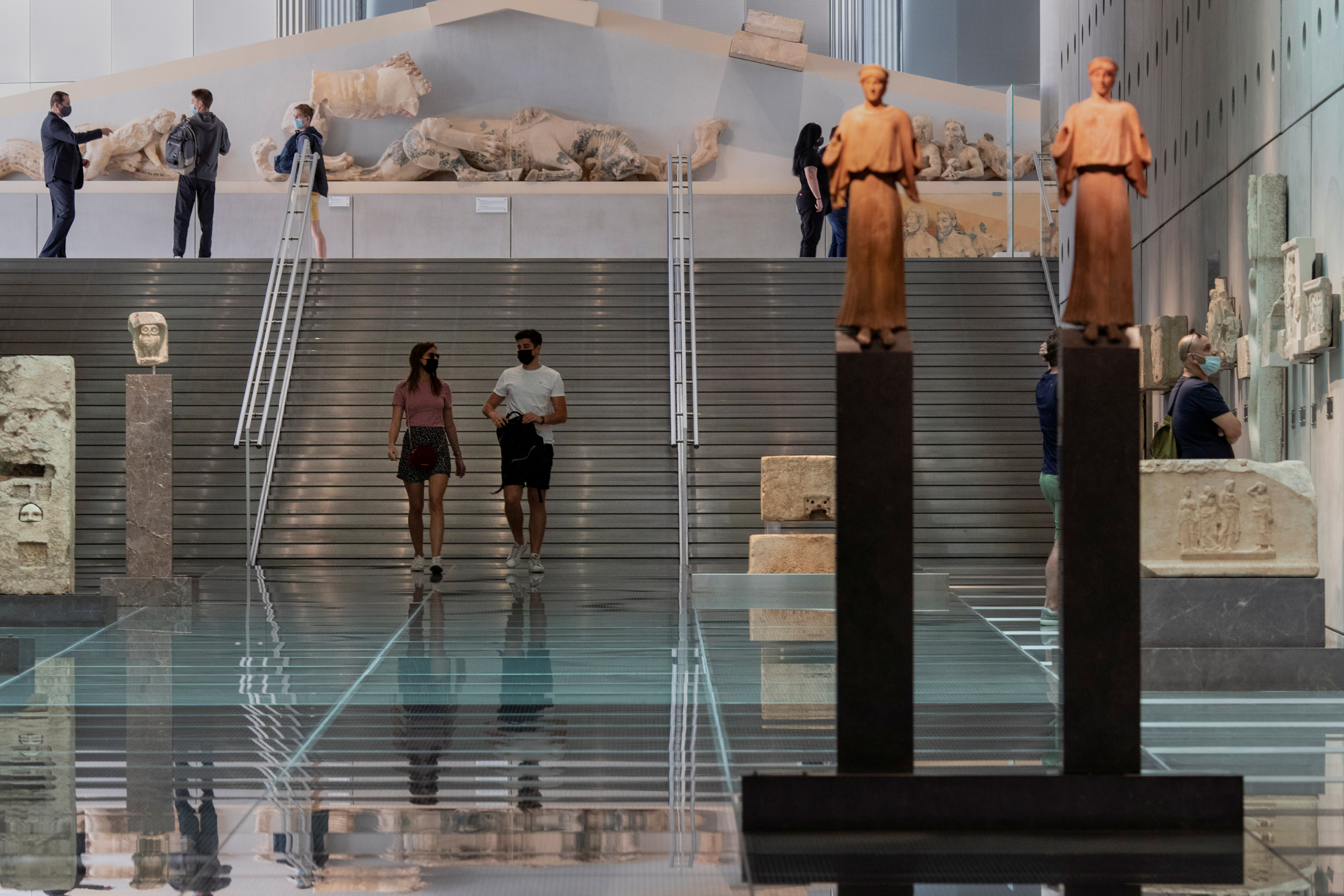 People visit the Acropolis Museum, as museums open following the easing of measures against the spread of the coronavirus disease (COVID-19), a day before the official opening of the tourism season, in Athens, Greece, May 14, 2021. REUTERS/Alkis Konstantinidis