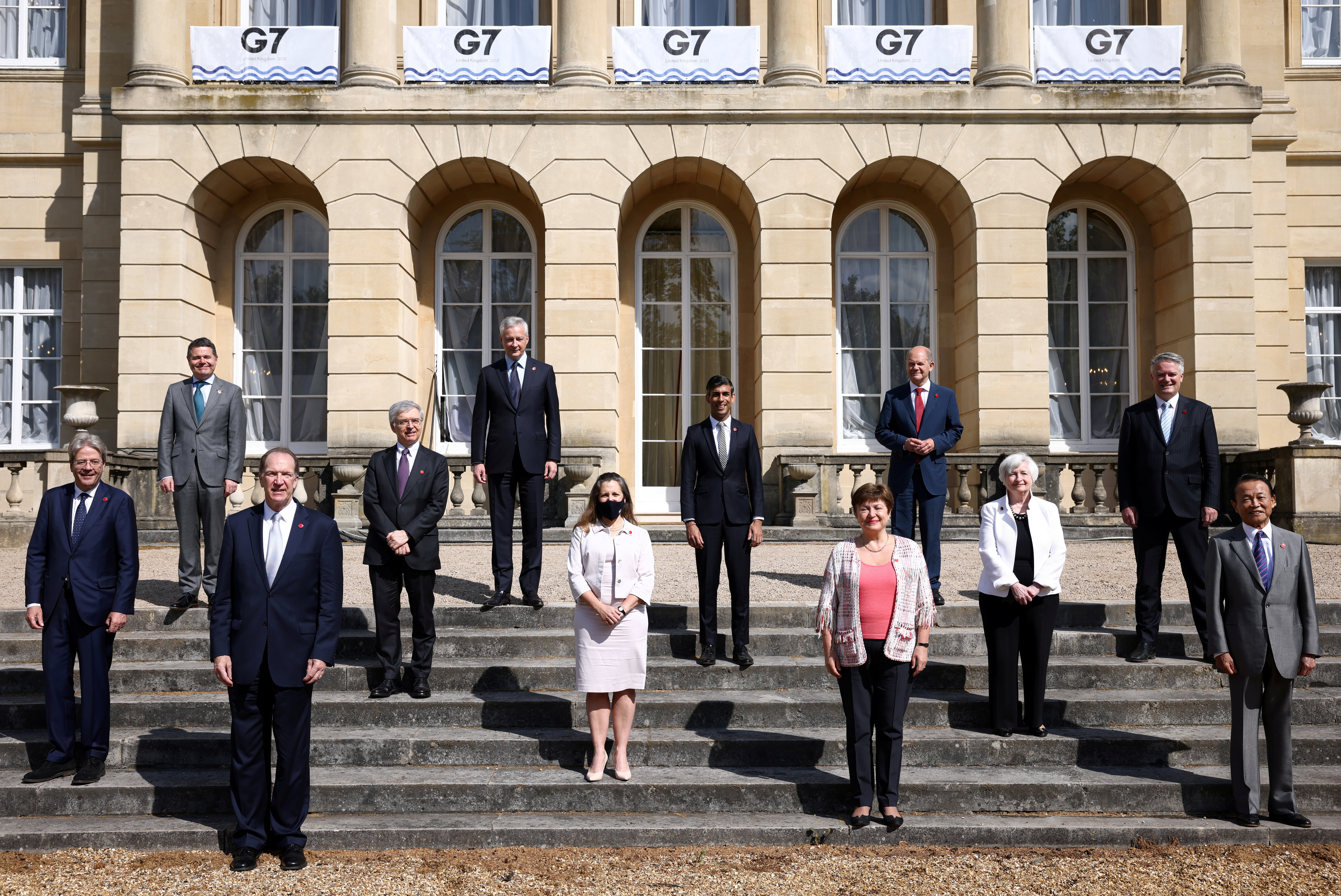 EU's Economy Commissioner Paolo Gentiloni, Eurogroup President Paschal Donohoe, World Bank President David Malpass, Italy's Finance Minister Daniele Franco, French Finance Minister Bruno Le Maire, Canada's Finance Minister Chrystia Freeland, Britain's Chancellor of the Exchequer Chancellor Rishi Sunak, Managing Director of the IMF Kristalina Georgieva, Germany's Finance Minister Olaf Scholz, U.S. Treasury Secretary Janet Yellen, Secretary-General of the Organisation for Economic Co-operation and Development (OECD) Mathias Cormann, Japan's Finance Minister Taro Aso pose for a family photo during the G7 finance ministers meeting at Lancaster House in London, Britain, June 5, 2021. REUTERS/Henry Nicholls/Pool/File Photo