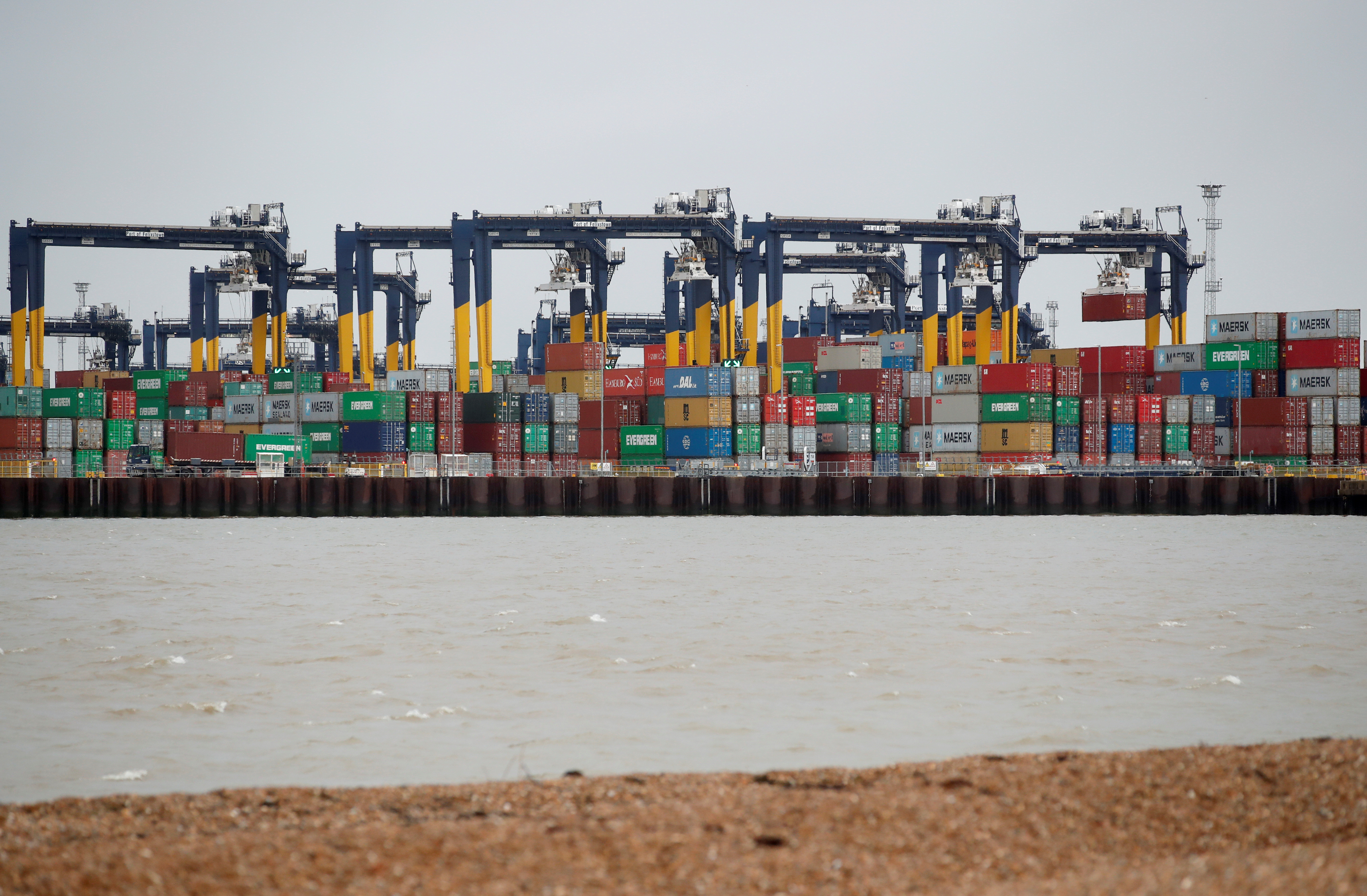 Containers are stacked at the Port of Felixstowe, Britain, January 28, 2021. Picture taken January 28, 2021.  REUTERS/Peter Cziborra