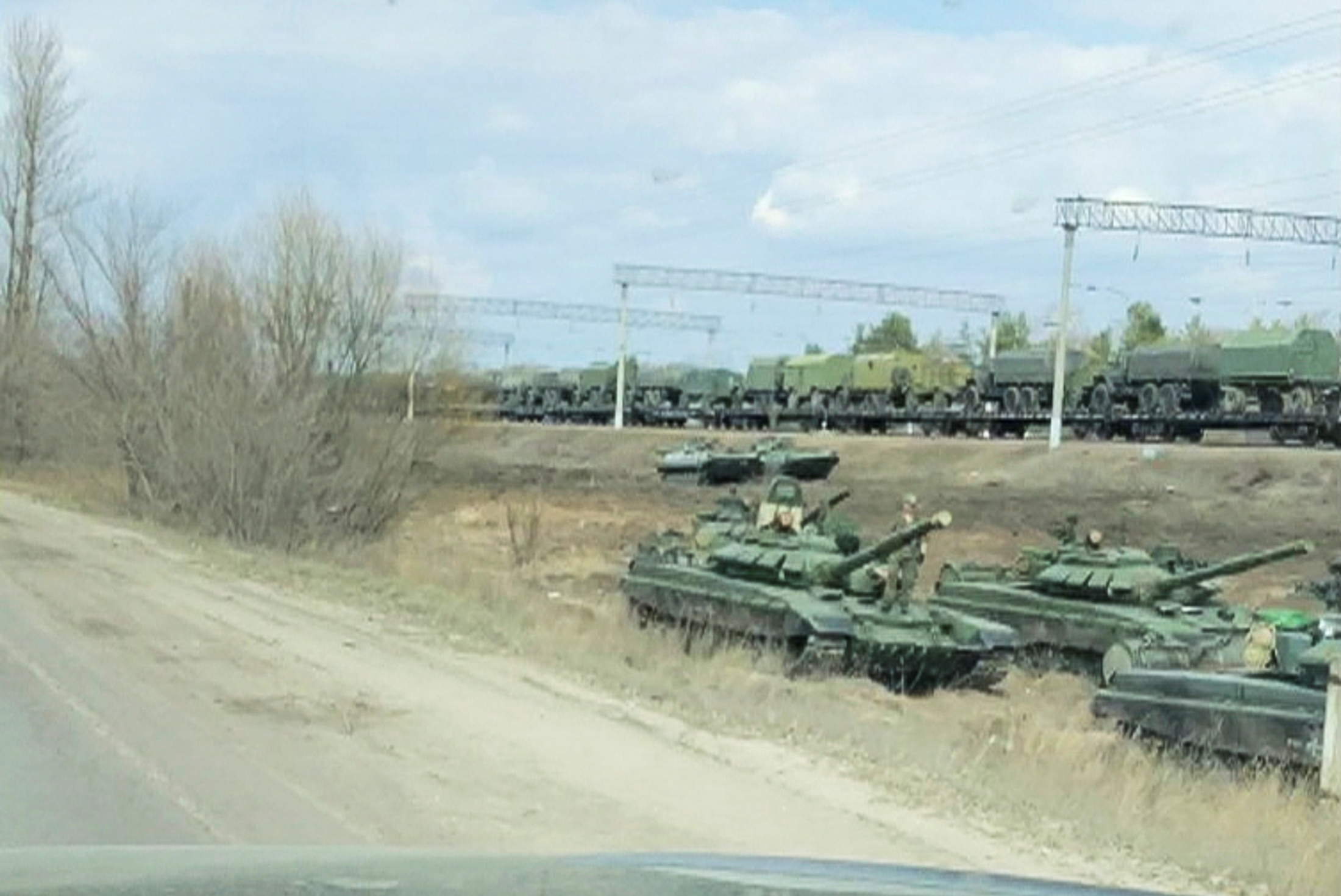 A still image from video shows tanks and military vehicles in Maslovka, Voronezh Region, Russia April 6, 2021. Video taken April 6, 2021. Video by REUTERS