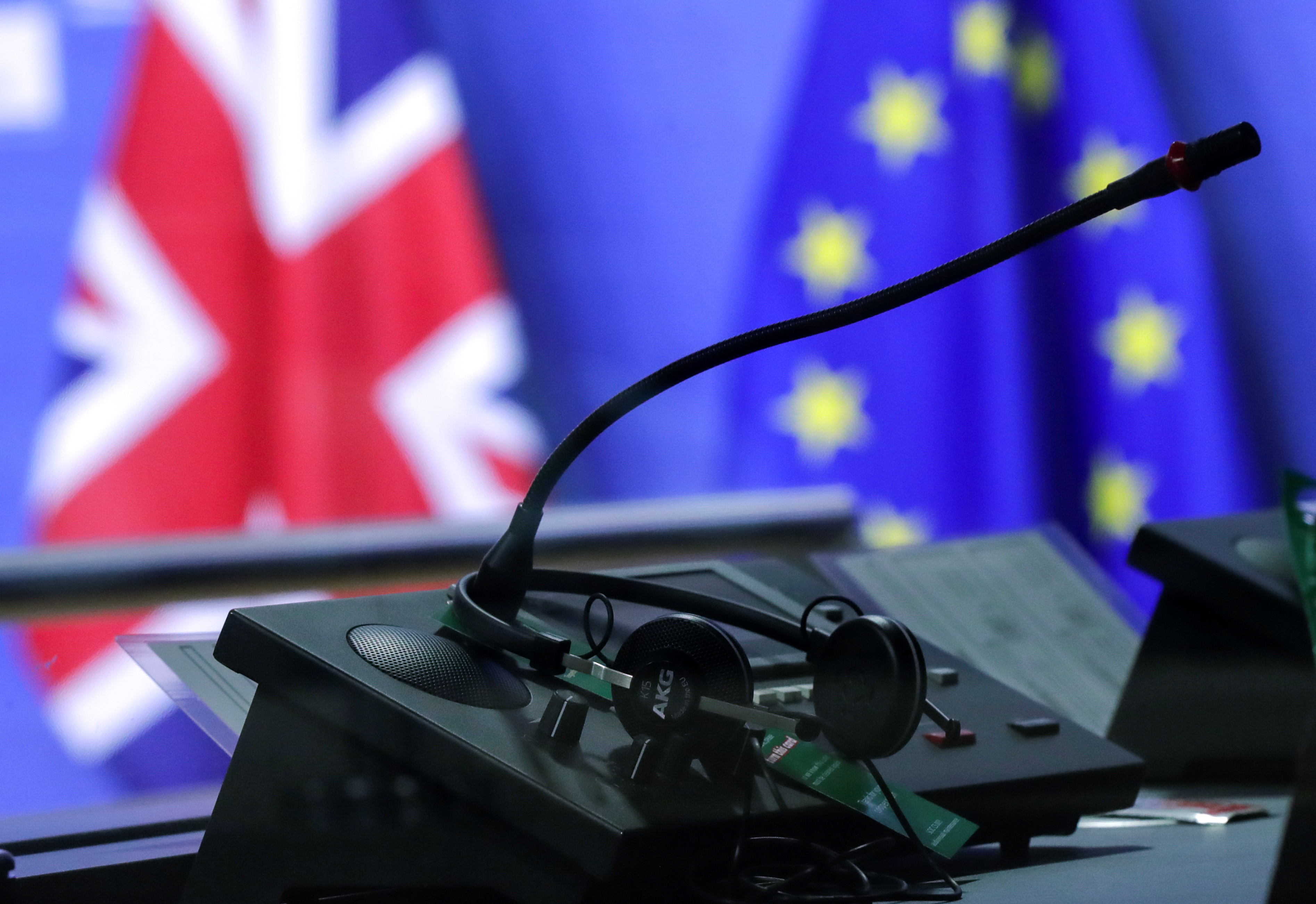 Flags of the Union Jack and European Union are seen through interpreters booth ahead of the meeting of European Commission President Ursula von der Leyen and British Prime Minister Boris Johnson, in Brussels, Belgium December 9, 2020. Olivier Hoslet/Pool via REUTERS