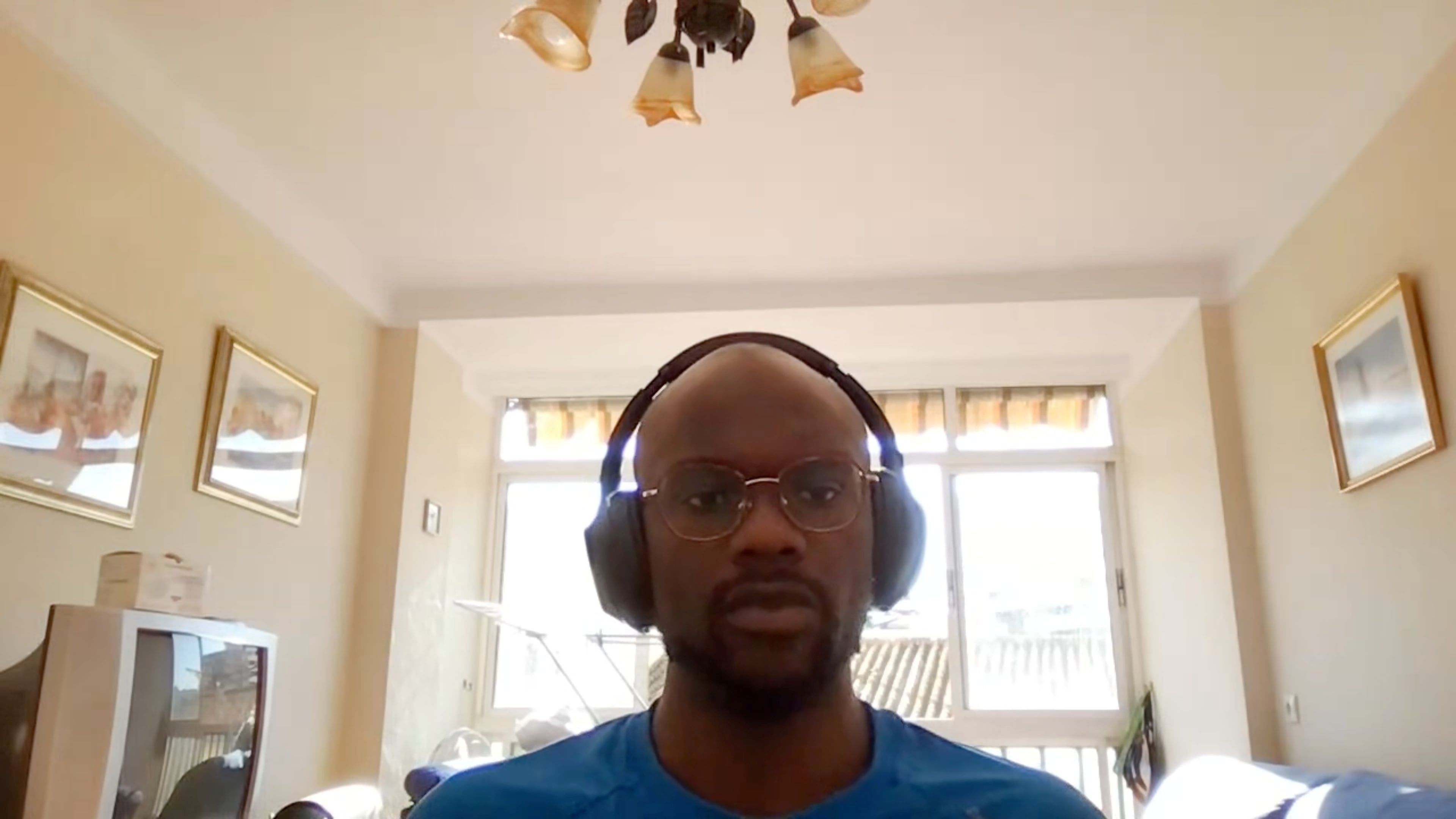 A screengrab dated June 2, 2021 shows a user during a Google Meet video call appearing brighter because of an upcoming light adjustments feature that uses artificial intelligence. Google/Handout via REUTERS