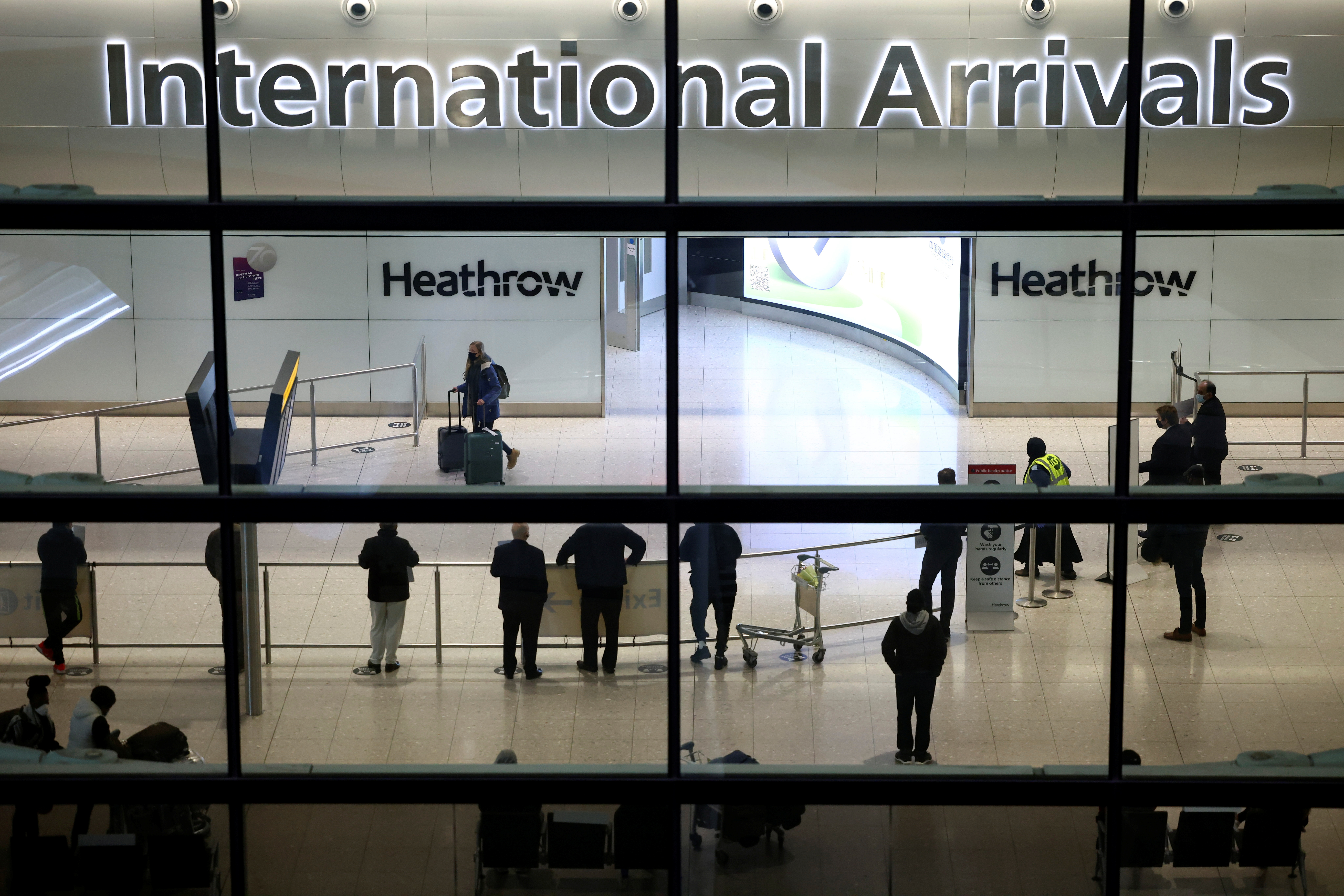 People wait at the arrivals area, as tighter rules for international travellers start, at terminal 2 of the Heathrow Airport, amid the spread of the coronavirus disease (COVID-19) pandemic, London, Britain, January 18, 2021. REUTERS/Henry Nicholls