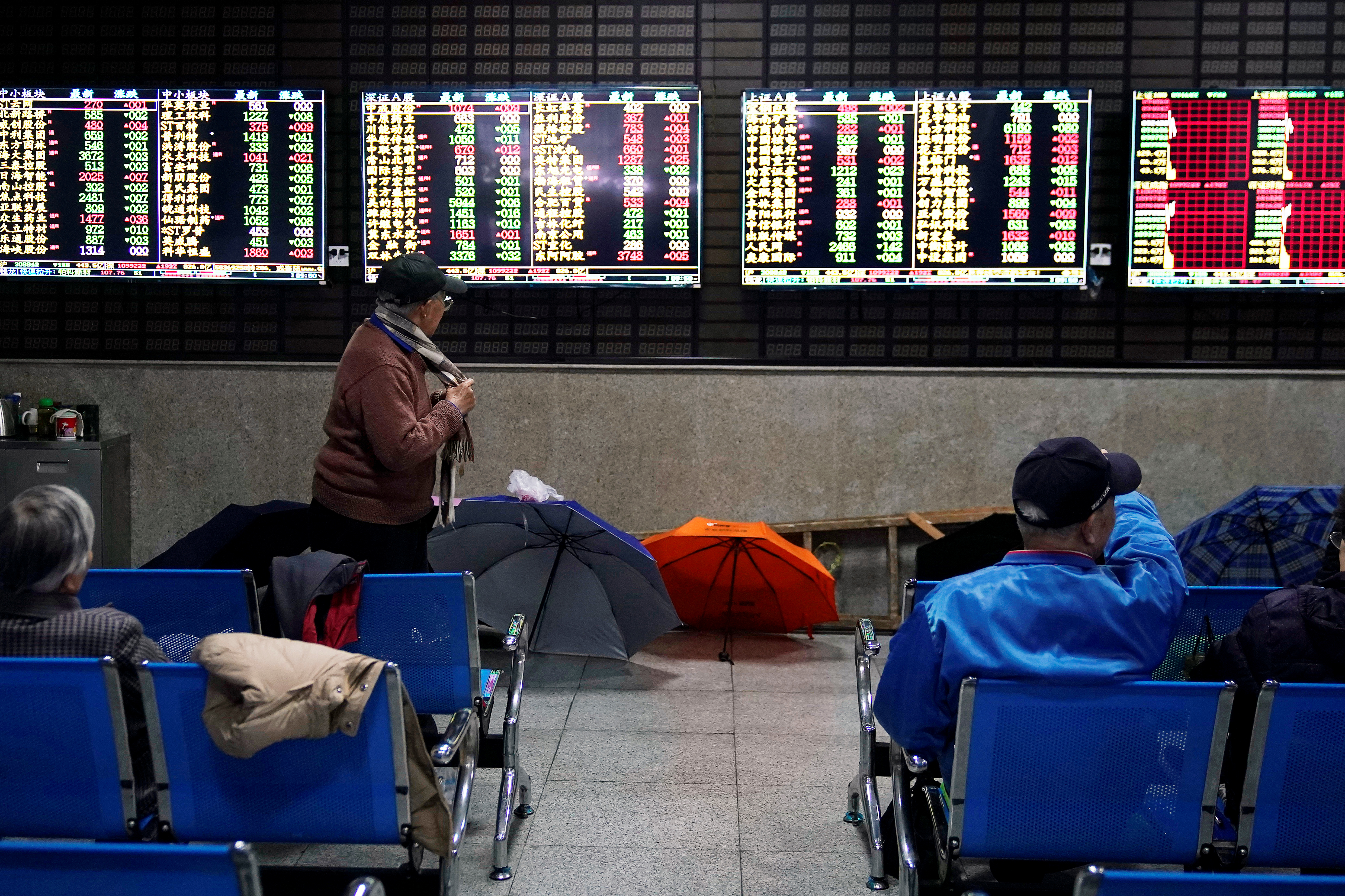 Investors look at screens showing stock information at a brokerage house in Shanghai, China January 16, 2020. REUTERS/Aly Song