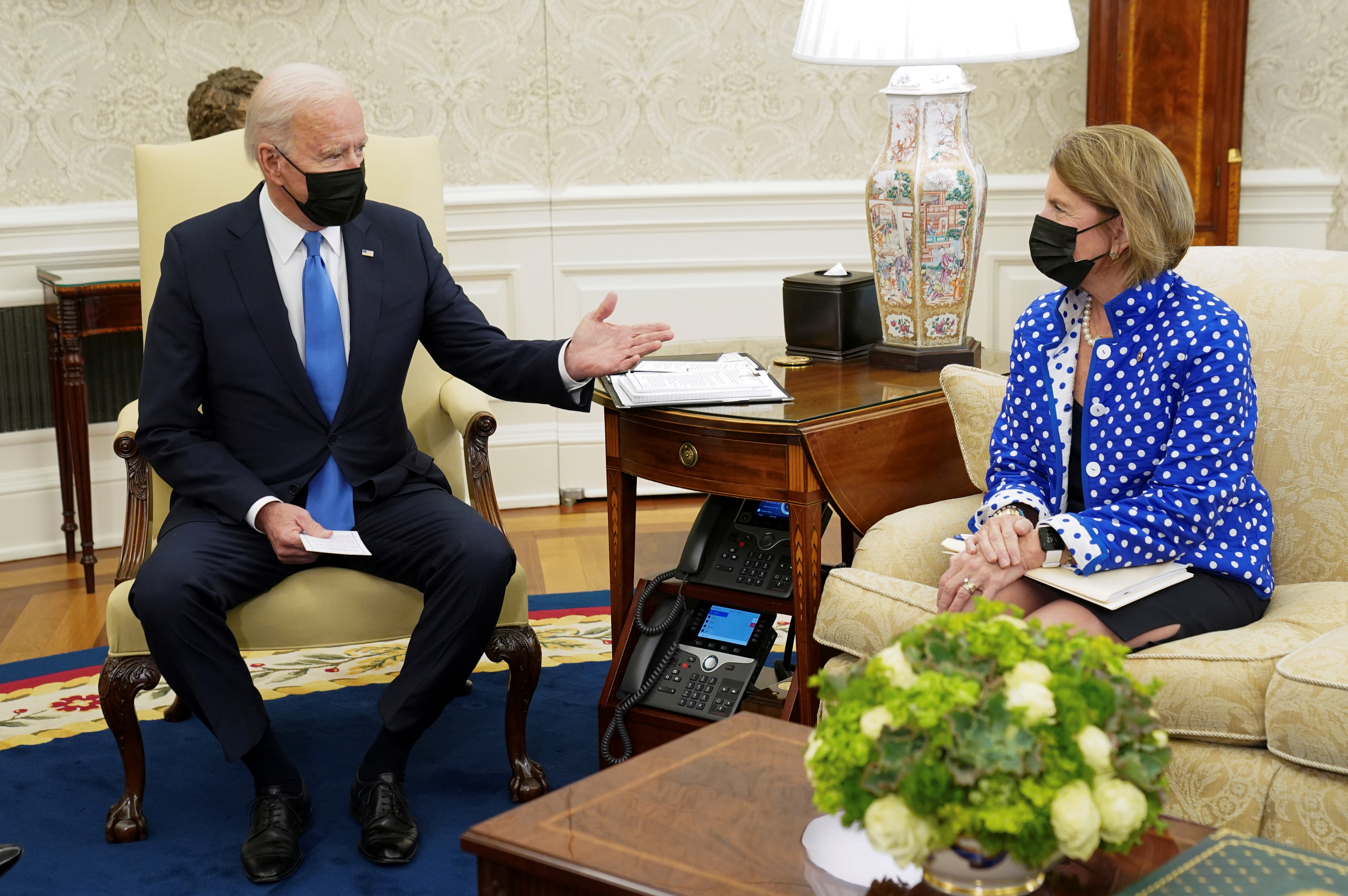 U.S. President Joe Biden gestures toward Senator Shelley Capito (R-WV) during an infrastructure meeting with Republican Senators at the White House in Washington, U.S., May 13, 2021. REUTERS/Kevin Lamarque/File Photo