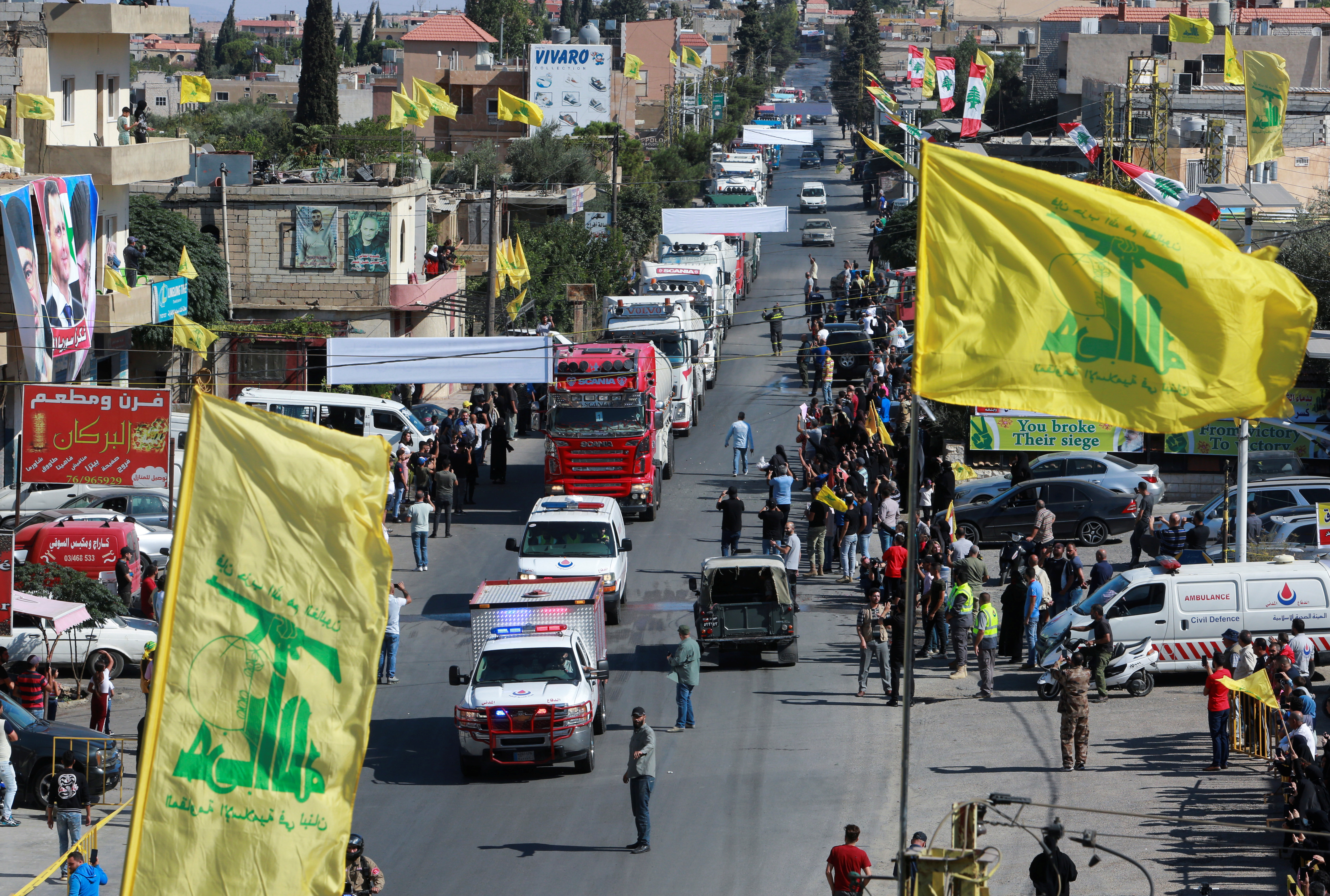 Hezbollah flags flutter as a convoy of tanker trucks carrying Iranian fuel oil arrive at al-Ain village in northeastern Lebanon, September 16, 2021. REUTERS/Aziz Taher
