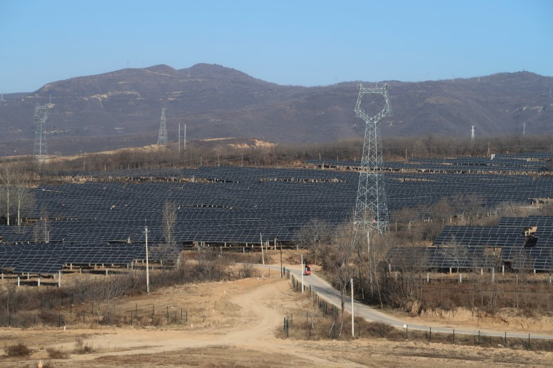 A solar power station is seen in Tongchuan, Shaanxi province, China December 11, 2019. Picture taken December 11, 2019. REUTERS/Muyu Xu