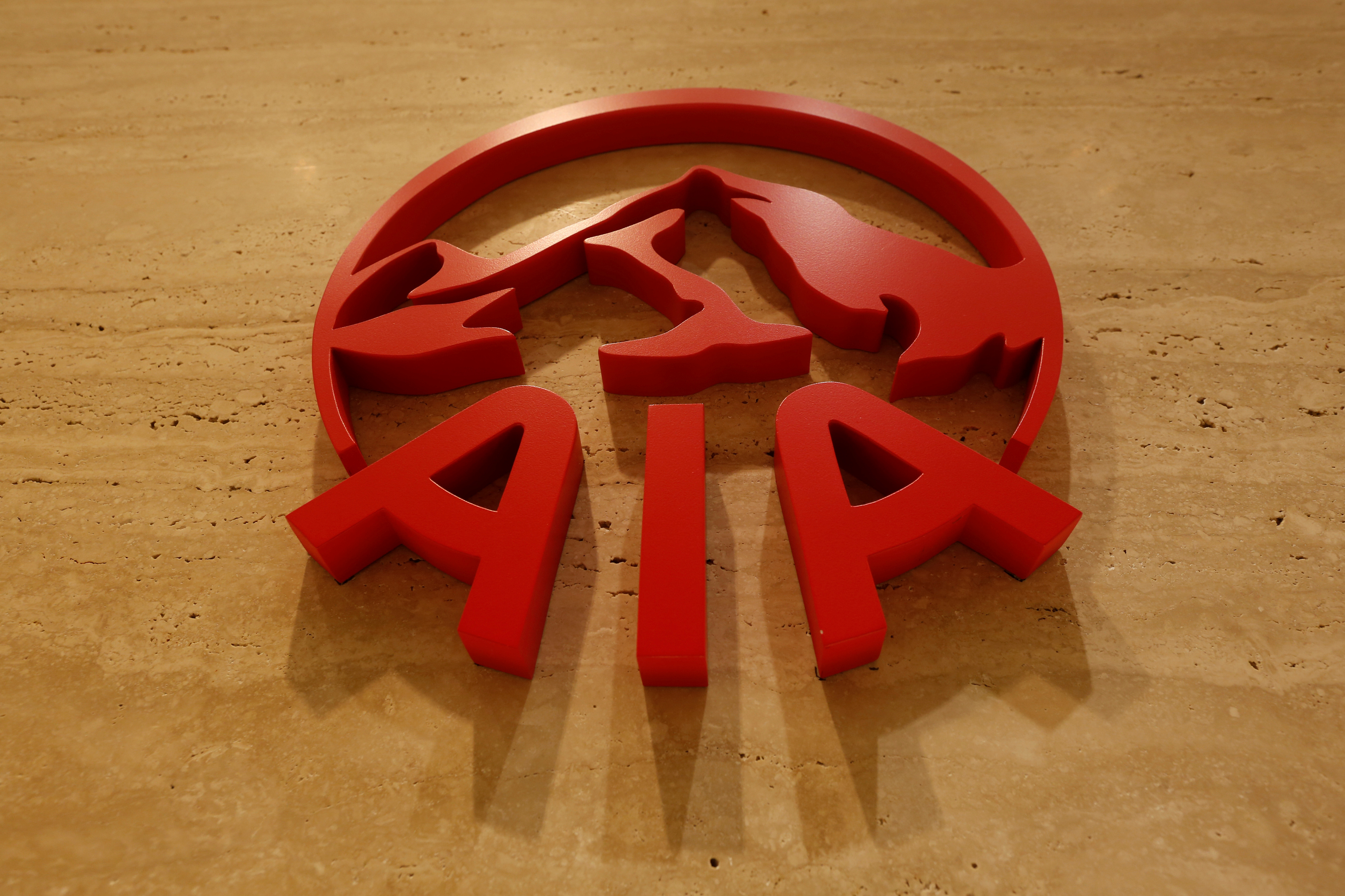 The logo of AIA is displayed at its office in Hong Kong, China February 24, 2017.      REUTERS/Bobby Yip