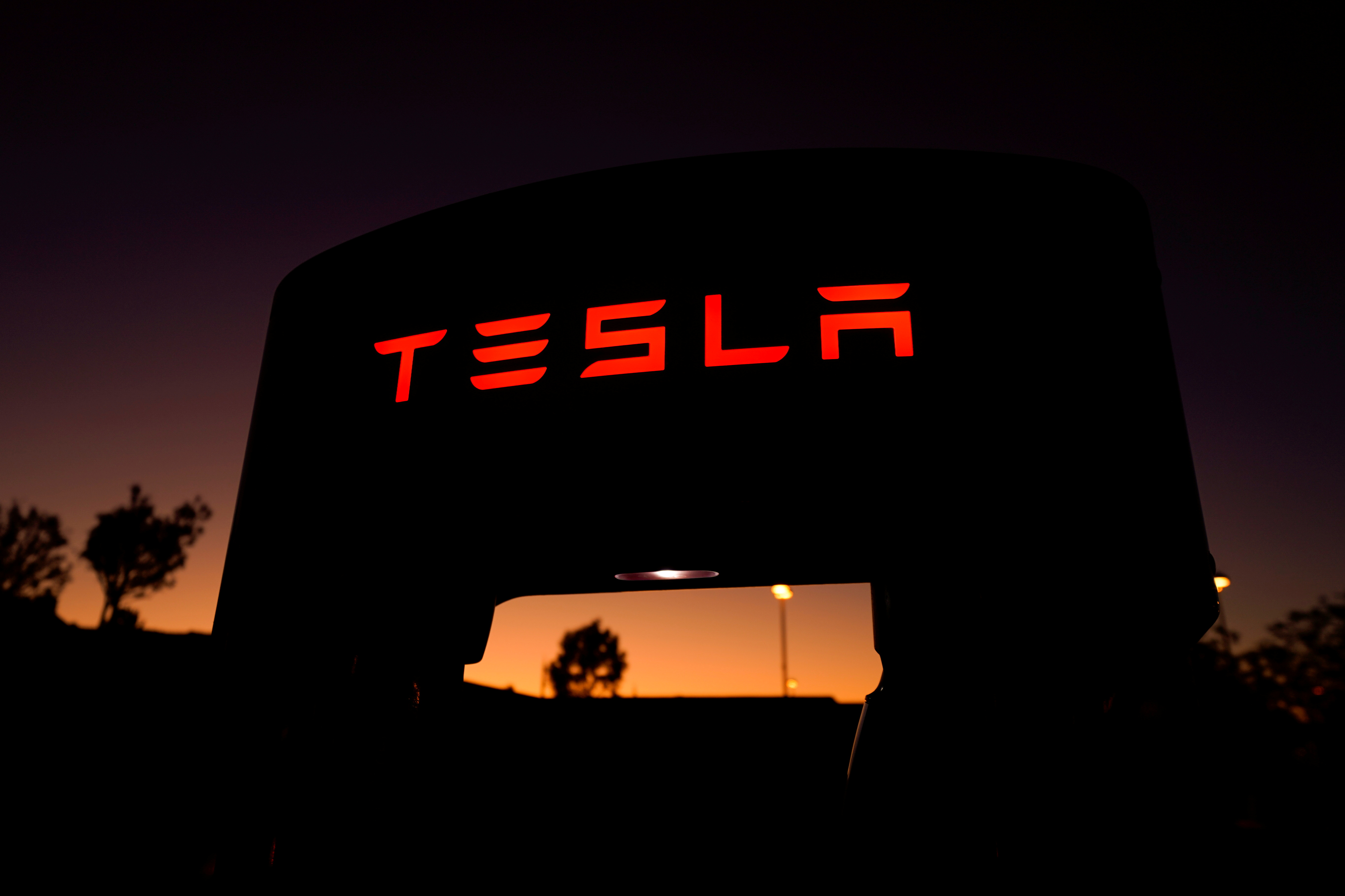 A Tesla supercharger is shown at a charging station in Santa Clarita, California, U.S. October 2, 2019. REUTERS/Mike Blake/File Photo