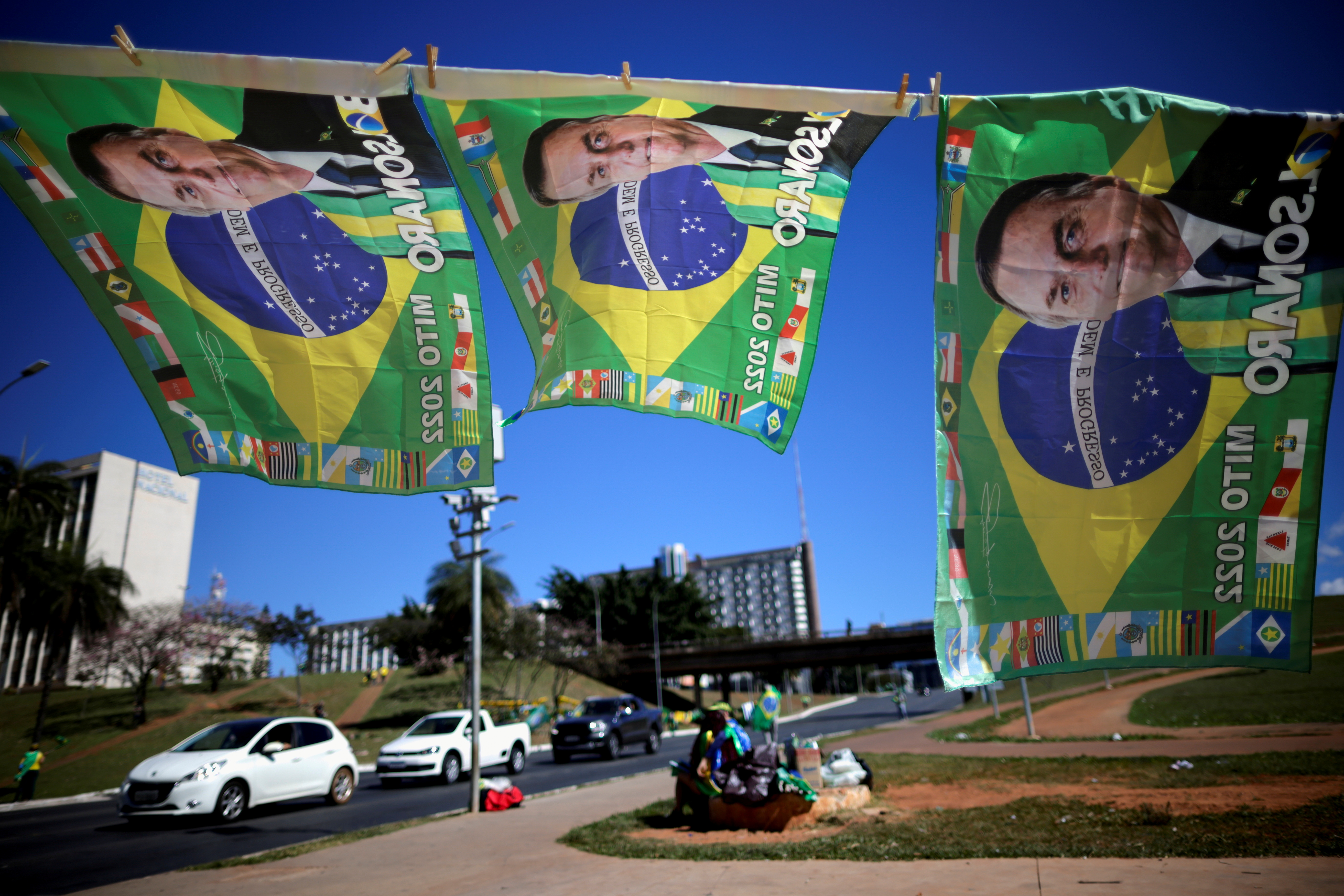 Flags with the image of Brazil's President Jair Bolsonaro are seen displayed for sale during a protest in support of him, amid the coronavirus disease (COVID-19) pandemic, in Brasilia, Brazil, June 27, 2021. REUTERS/Ueslei Marcelino/File Photo