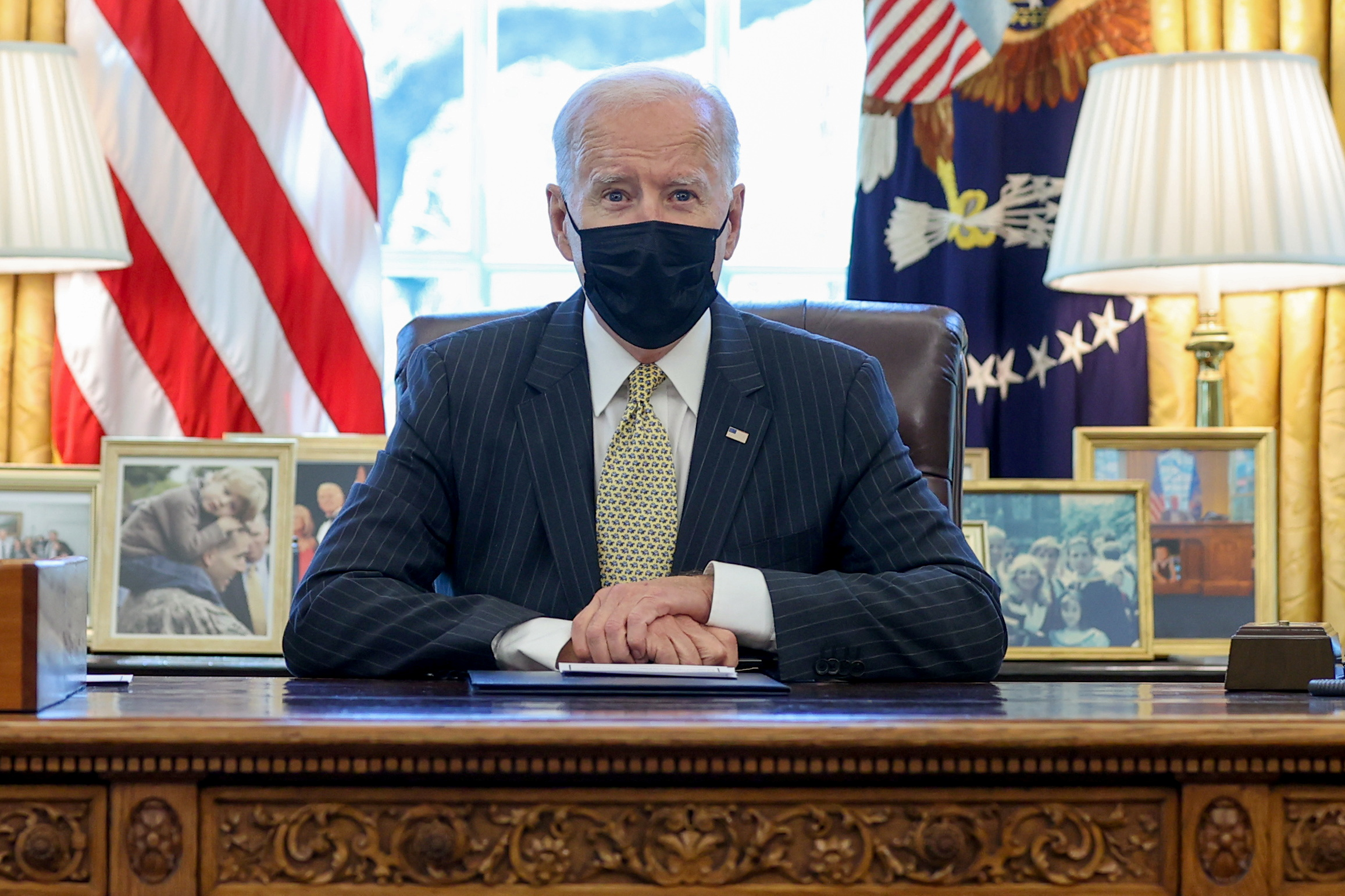 U.S. President Joe Biden speaks prior to signing the