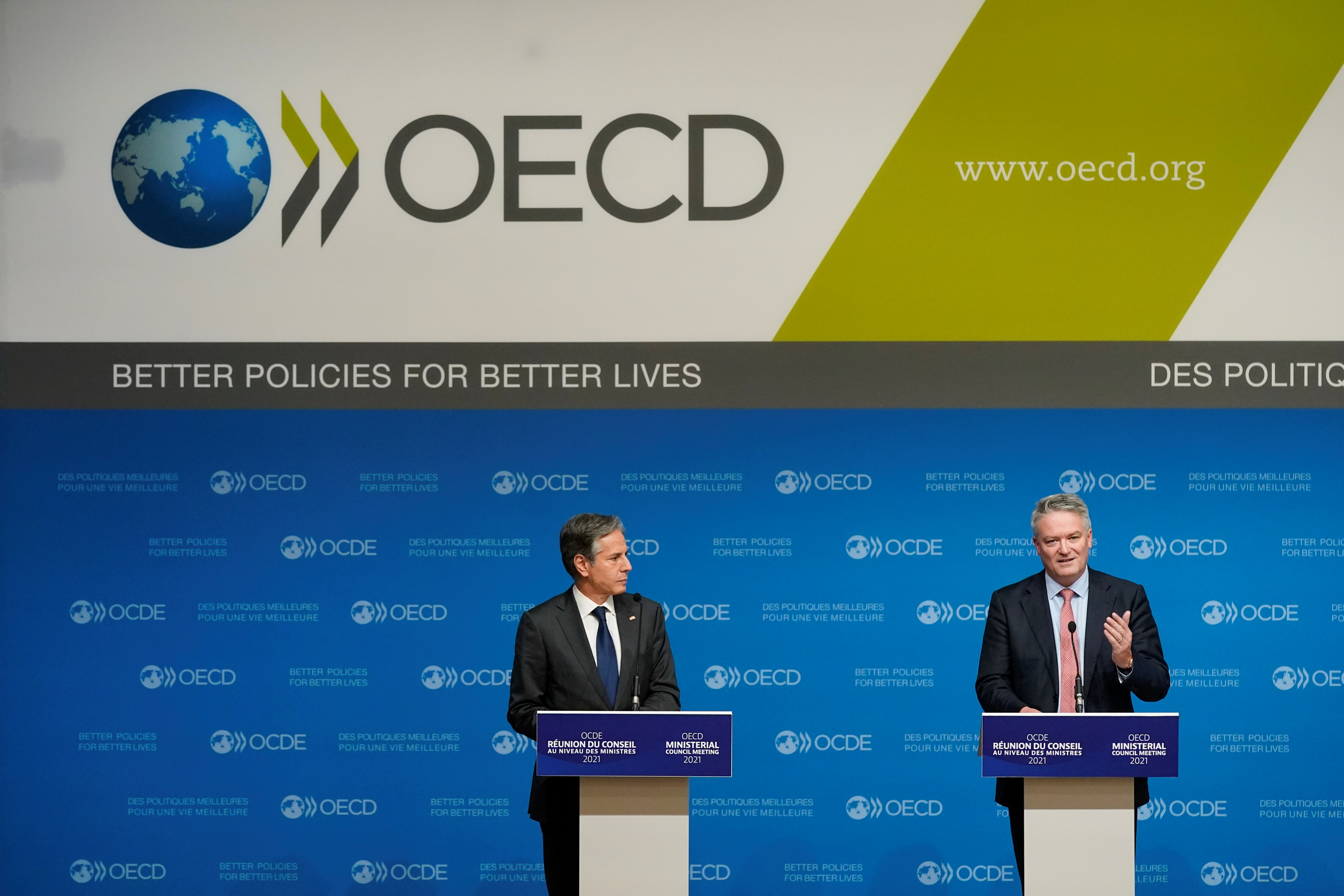 U.S. Secretary of State Antony Blinken listens as Mathias Cormann, Secretary-General of the Organization for Economic Cooperation and Development, speaks during a press briefing at the OECD's Ministerial Council Meeting, in Paris, France October 6, 2021.  Patrick Semansky/Pool via REUTERS