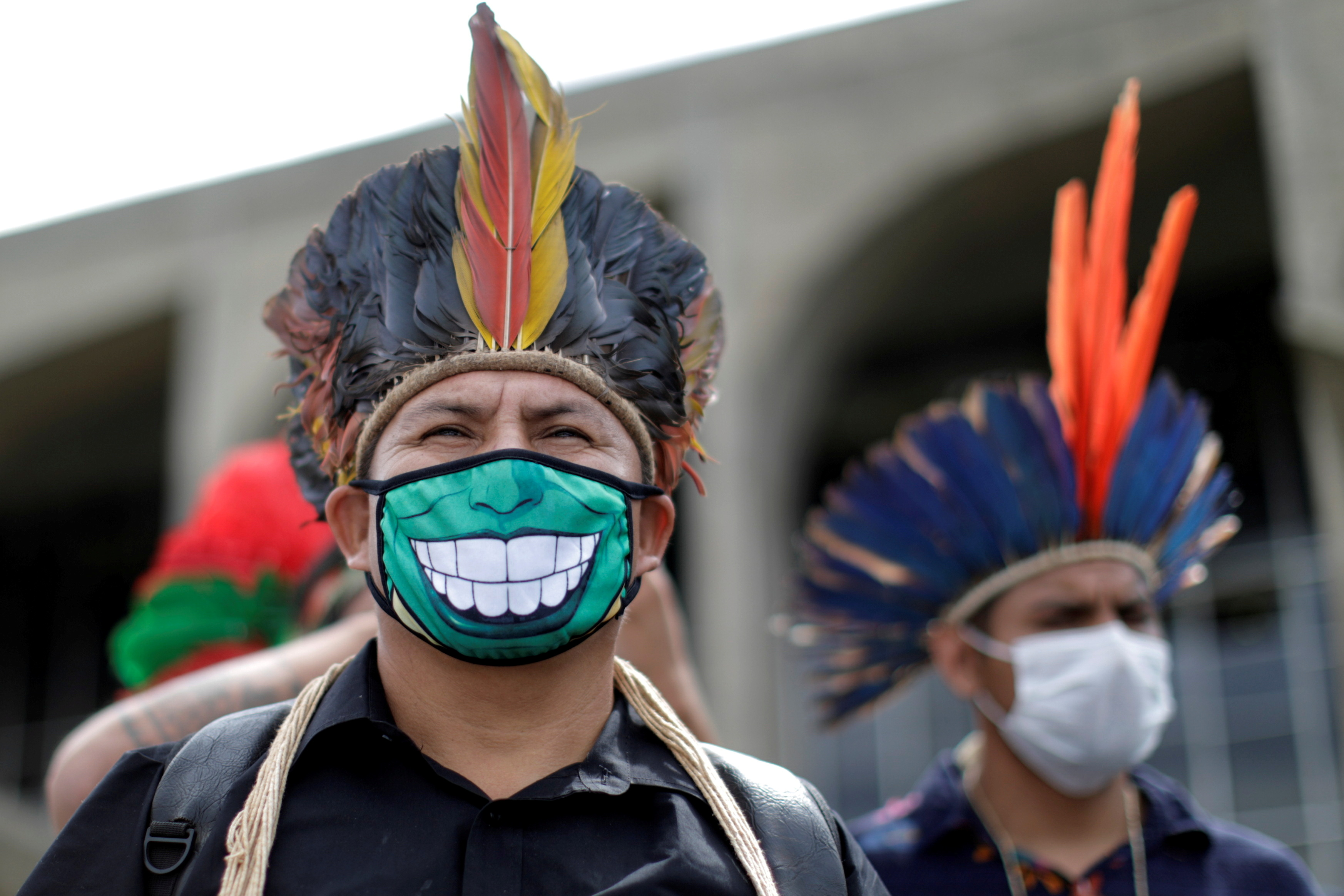 Indigenous people of several ethnic groups protest calling for the demarcation of their lands and the resignation of the Minister of Environment, Ricardo Salles, in Brasilia, Brazil, April 20, 2021. REUTERS/Ueslei Marcelino/File Photo