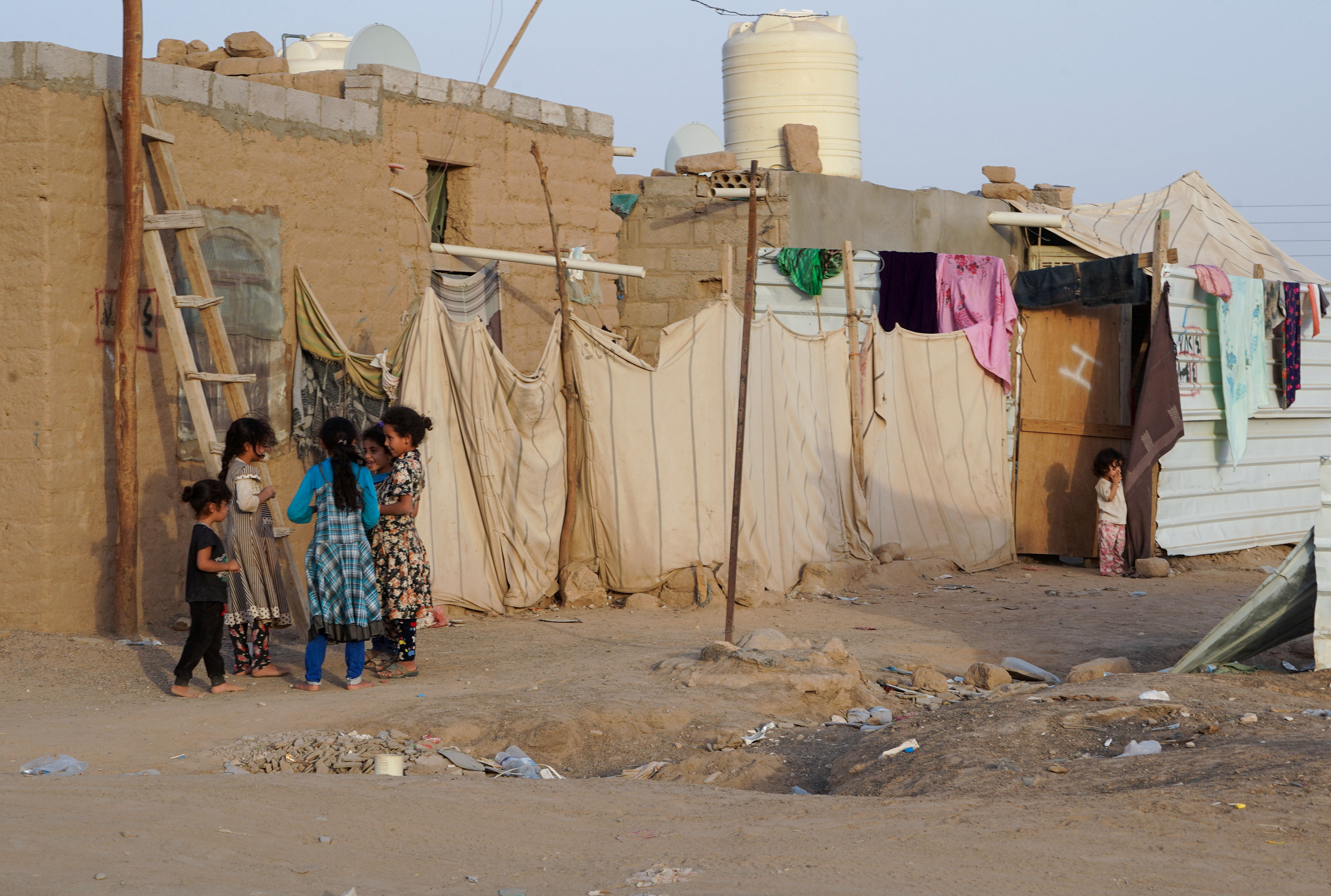 Girls play at a makeshift camp for internally displaced people (IDPs) in the oil-producing Marib province, Yemen May 10, 2021. REUTERS/Nabeel al-Awzari